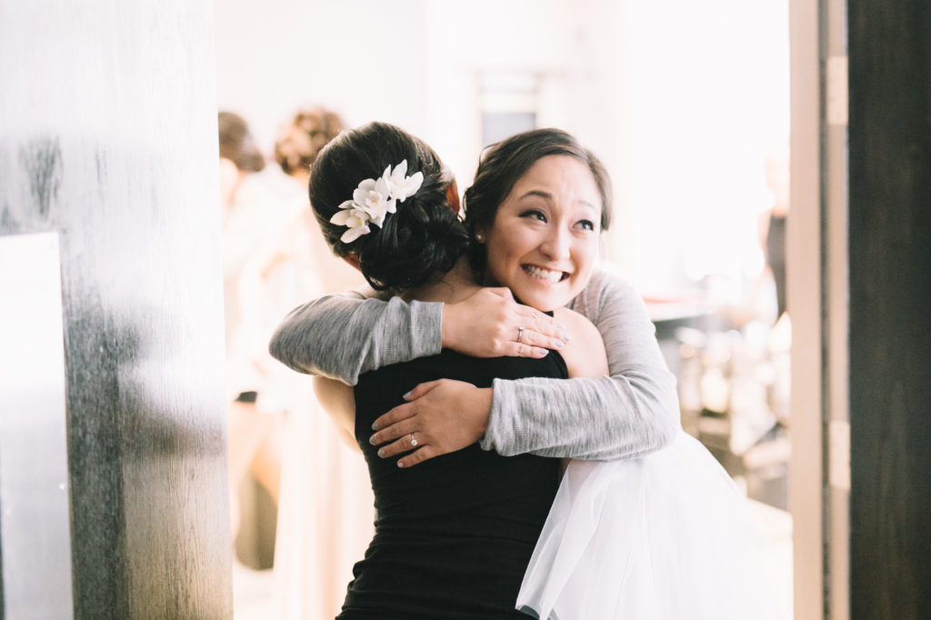 Maid of Honour hugging bride