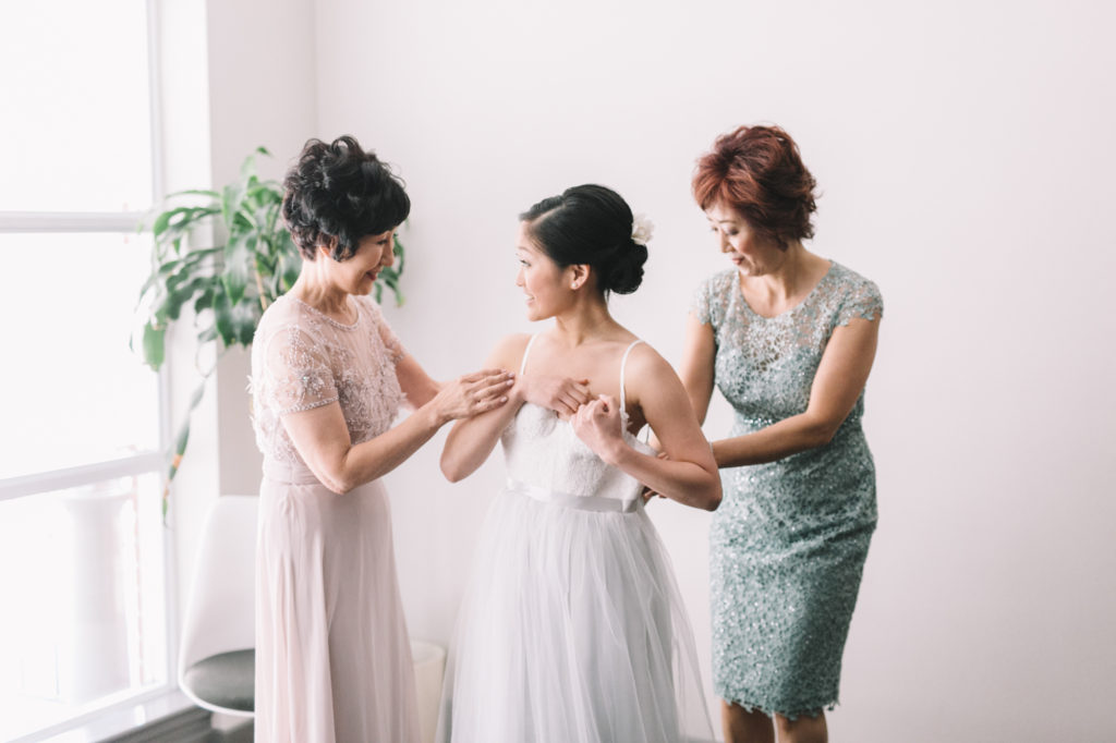 Mother's helping bride get ready