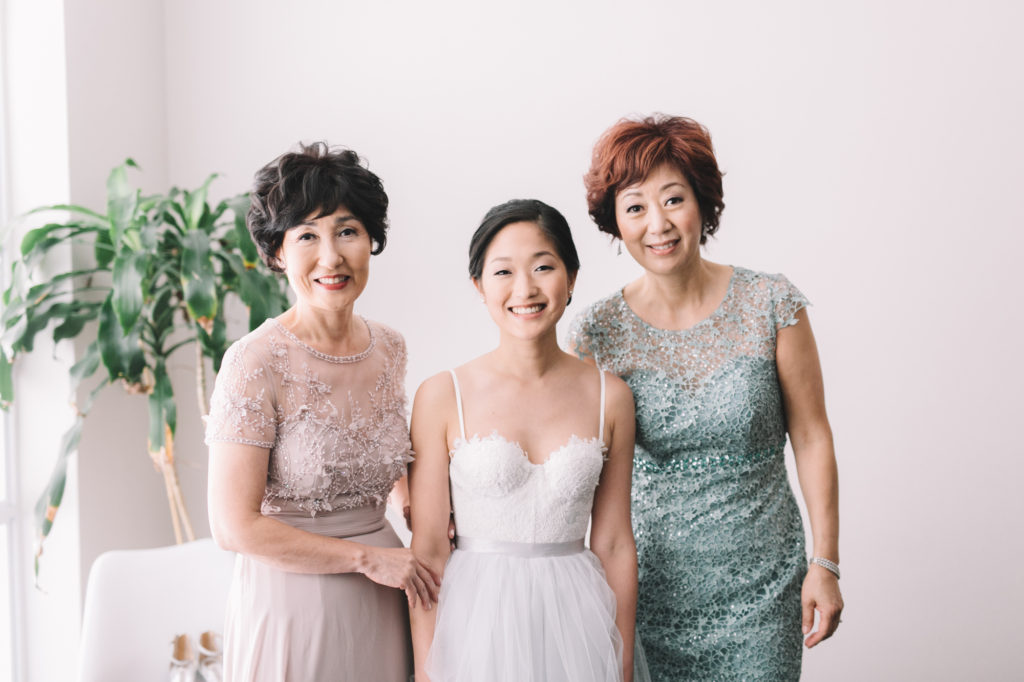 Family photo of bride with mothers