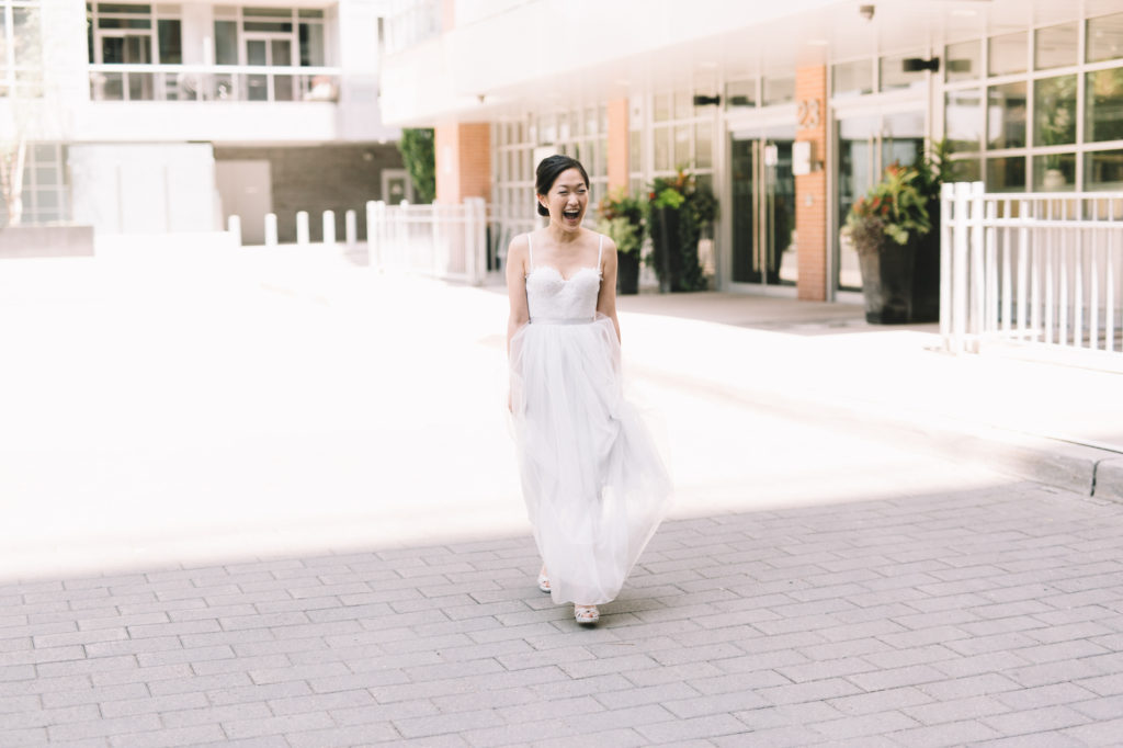 Bride walking to first look