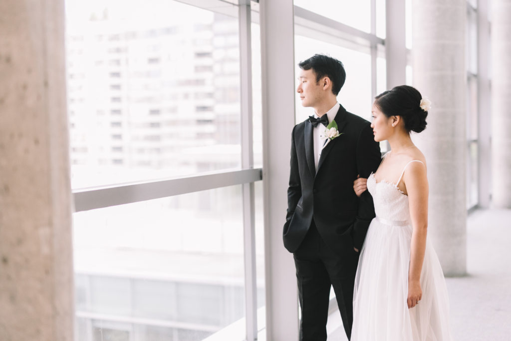 Bride and groom looking outside