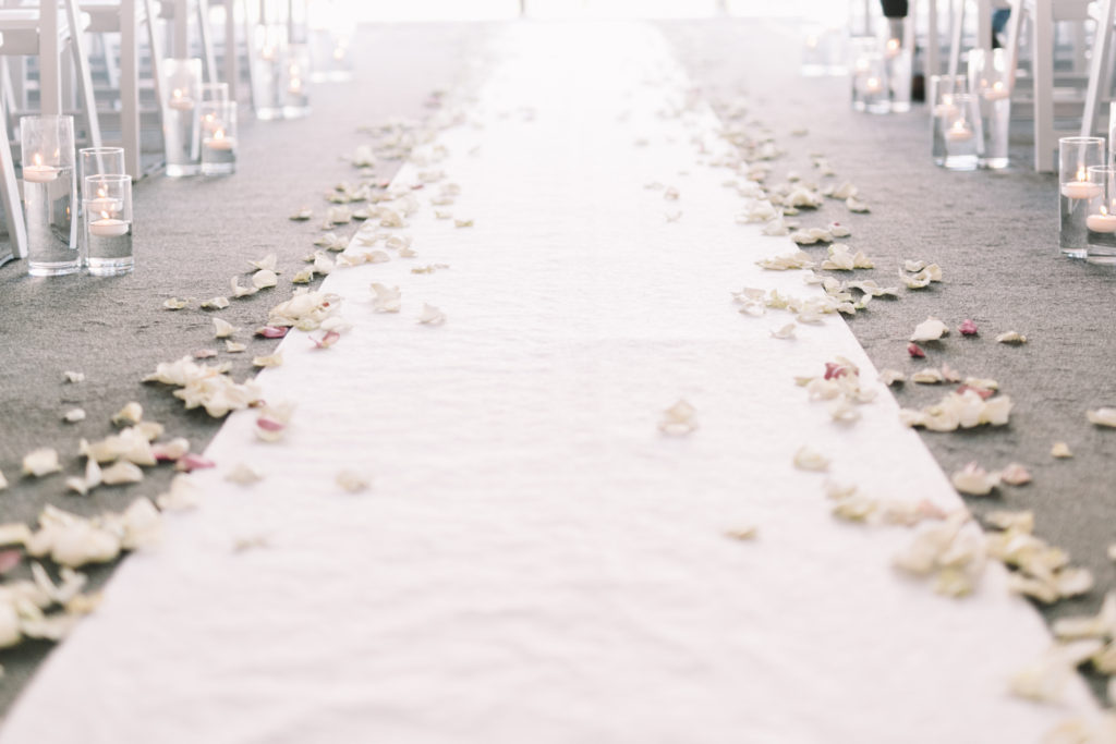 Ceremony detail photos with rose pedals