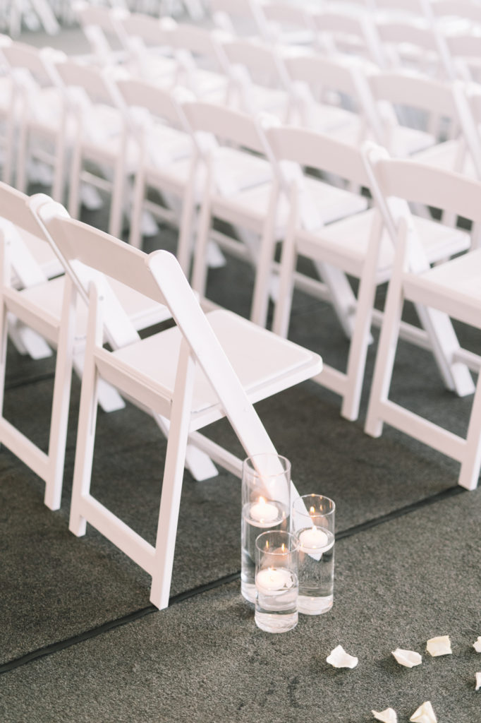 Detail ceremony photo of chairs and candles