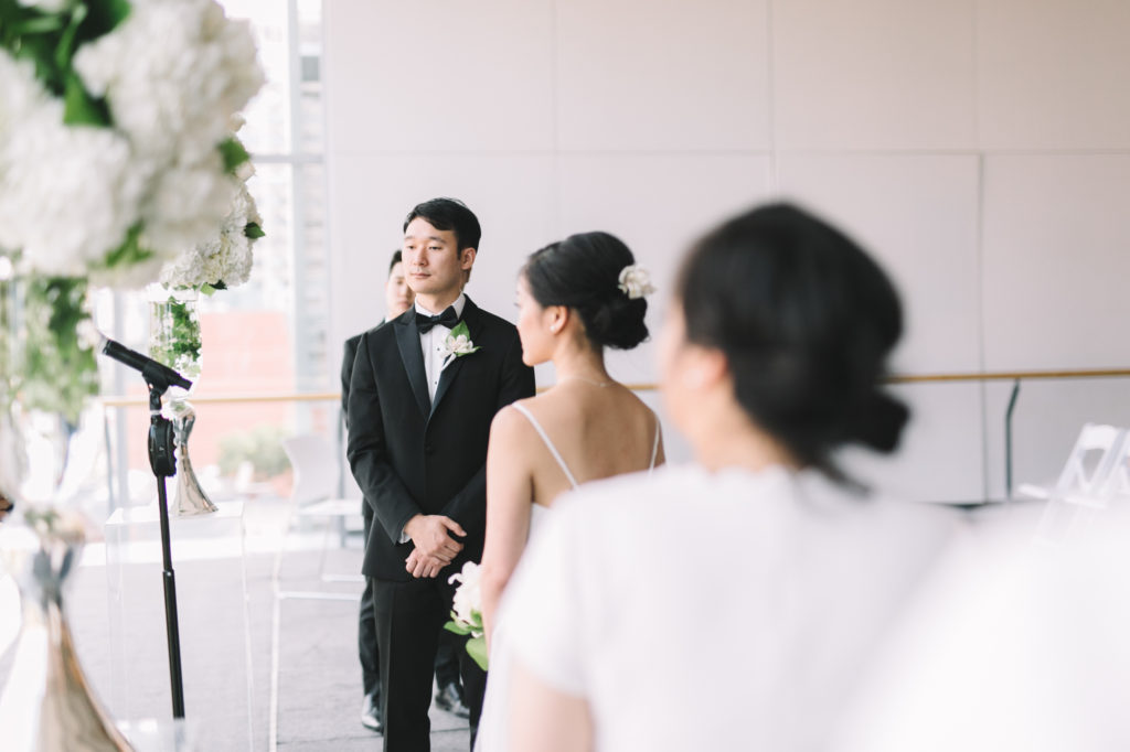 Ceremony photo of Groom listening