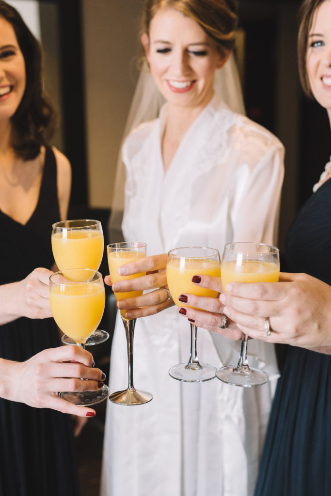 Bride toasting with bridesmaids