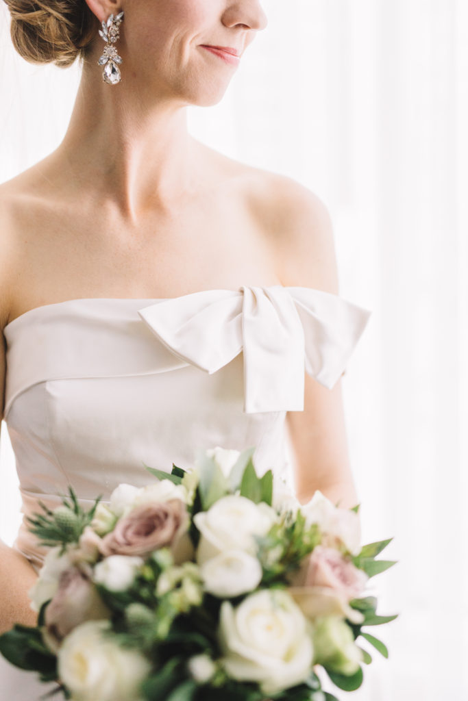 Detail photo of bride with flowers