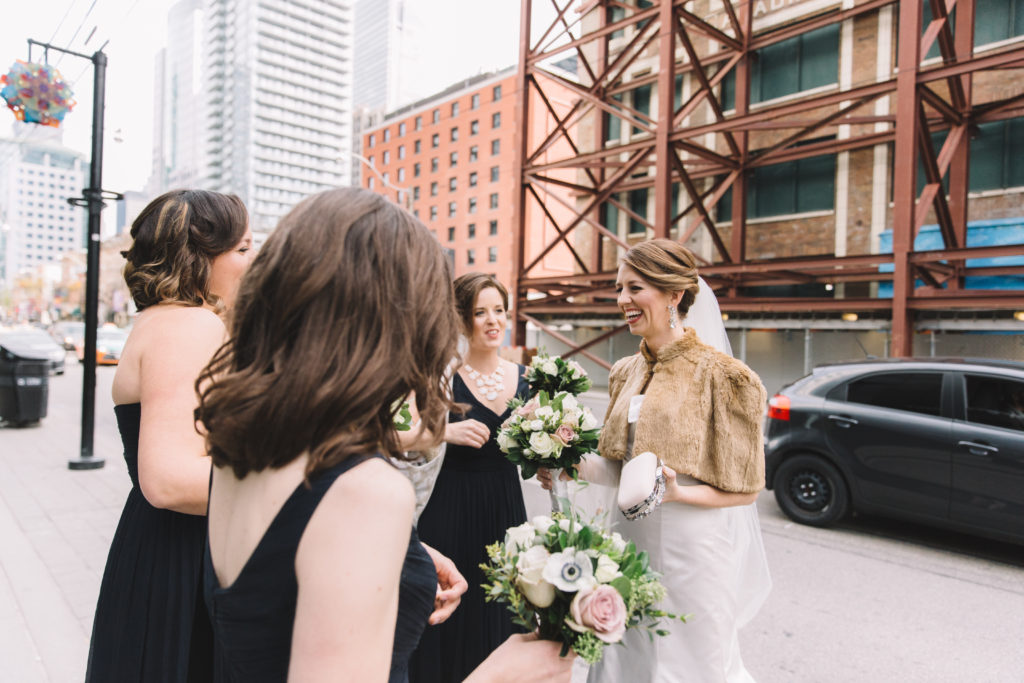 Bride and bridesmaid waiting for bus