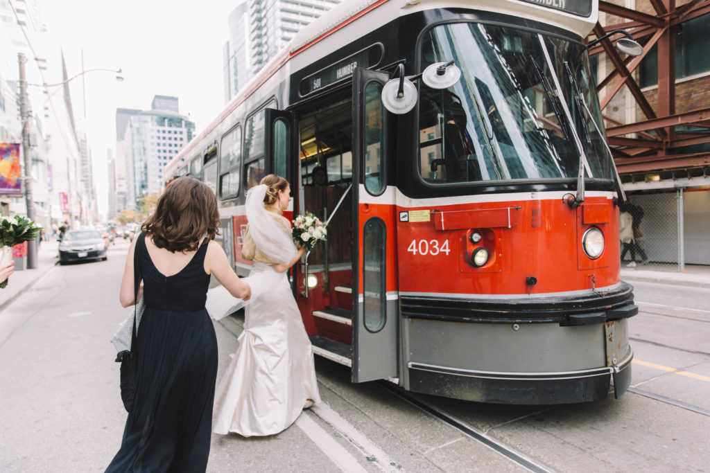 Bride getting onto streetcar