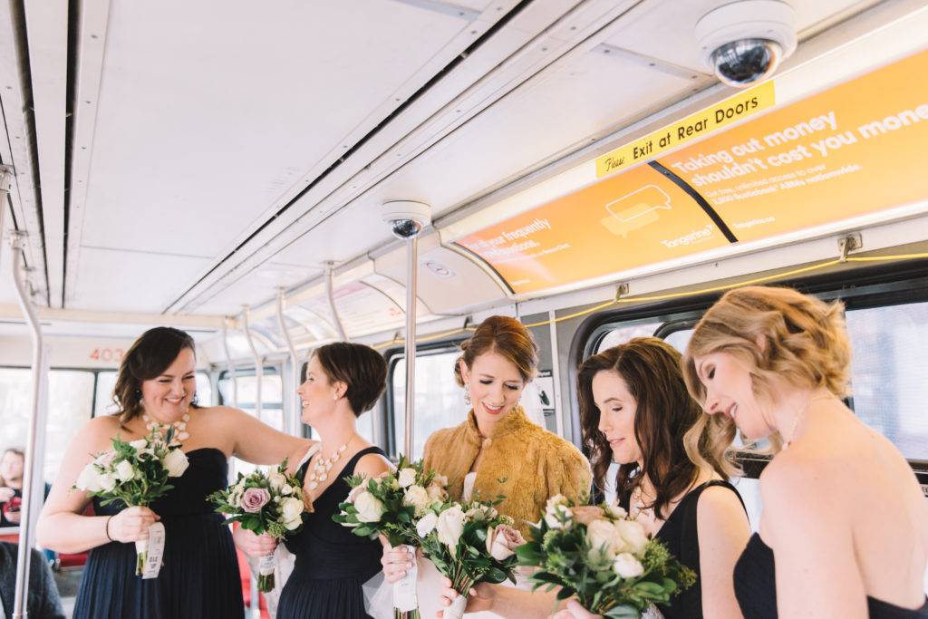 Bride and bridesmaids on streetcar in Toronto