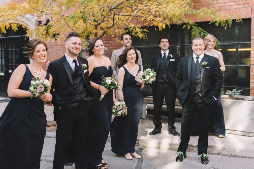 Bridal party watch and laughing