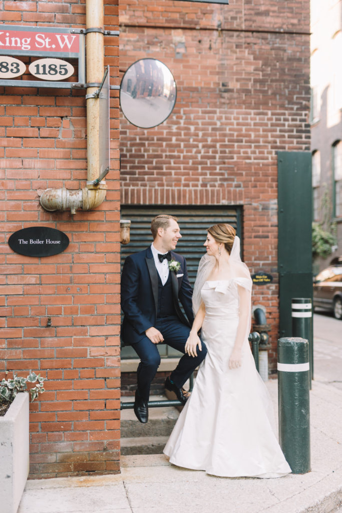 Bride and groom hanging in the Liberty village
