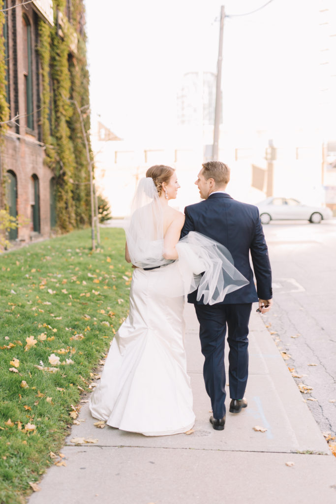 Bride and groom walking in Liberty Village in Toronto