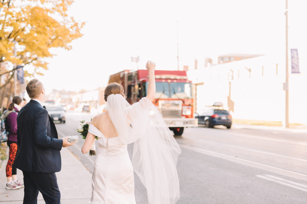 Bride waving at Fire truck passing by