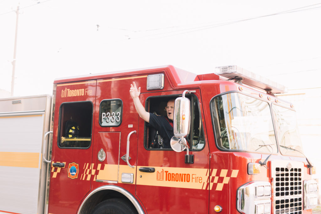 Fire truck honking back at bride and groom