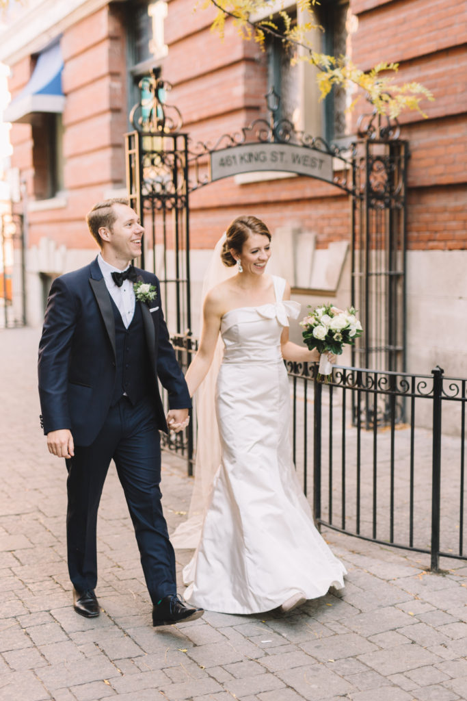 Bride and groom walking to 2nd Floor Events