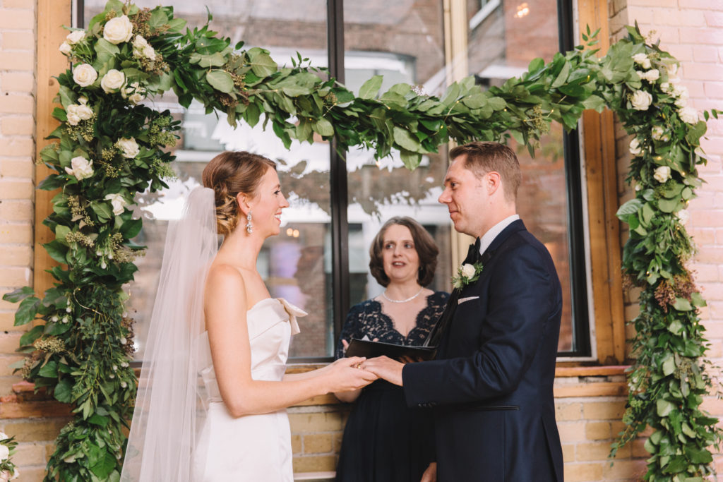 Bride and groom reading vows at 2nd Floor Events
