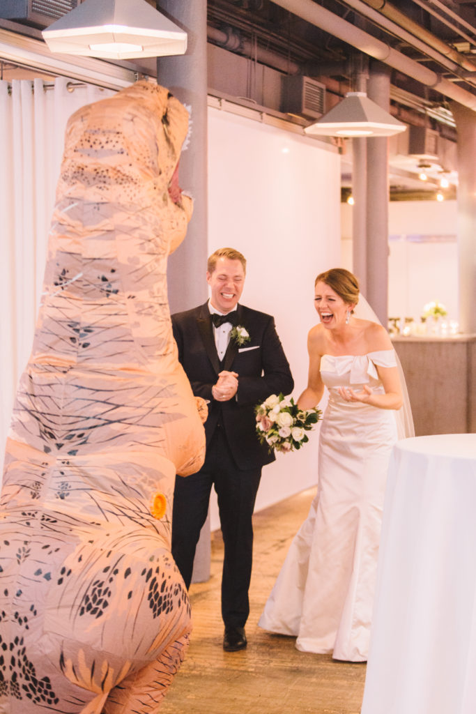 Groom surprises bride with dinosaur costume