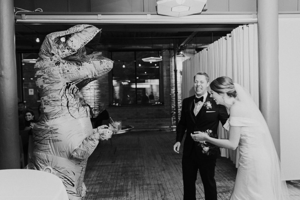 Groom surprises bride with dinosaur