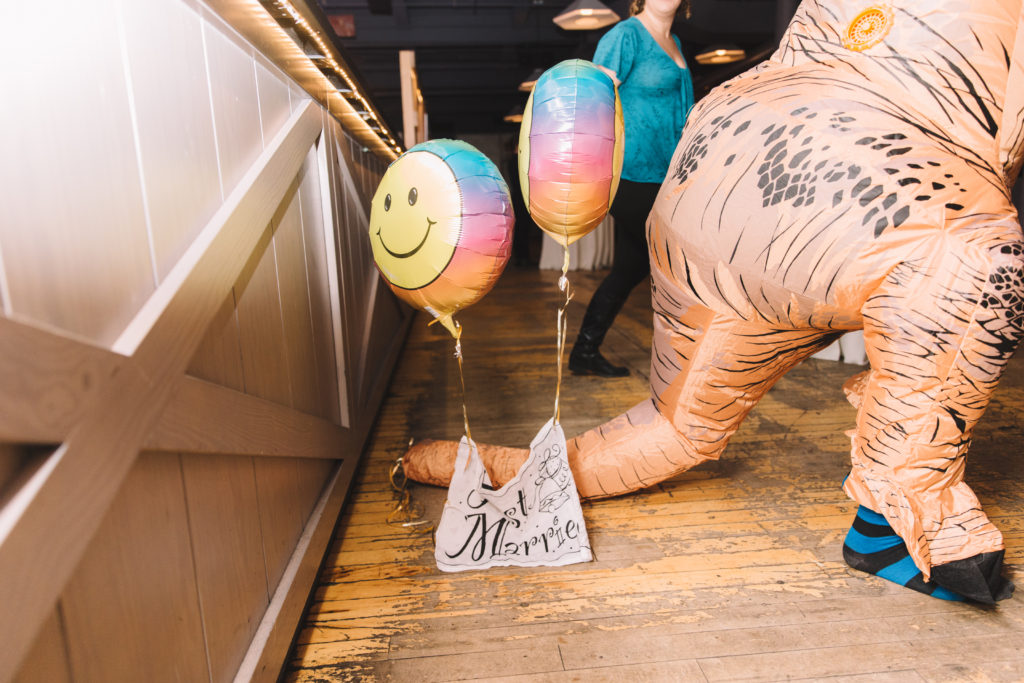 Just married sign on dinosaurs tail