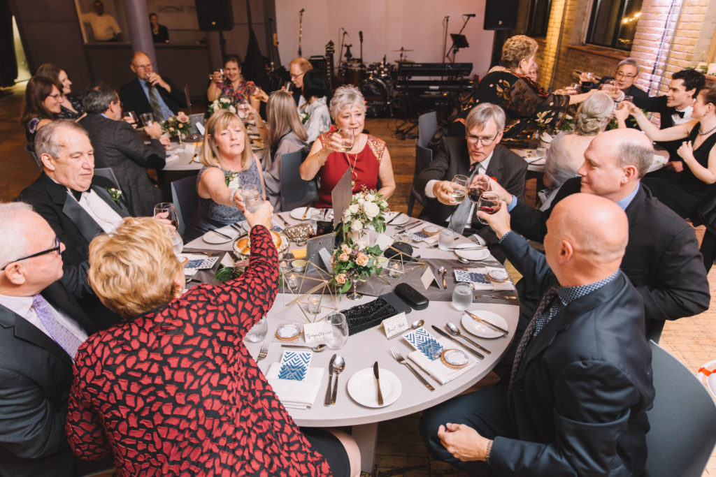 Tables cheering at 2nd Floor Events Wedding