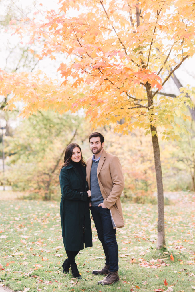 Portrait of couple under fall tree