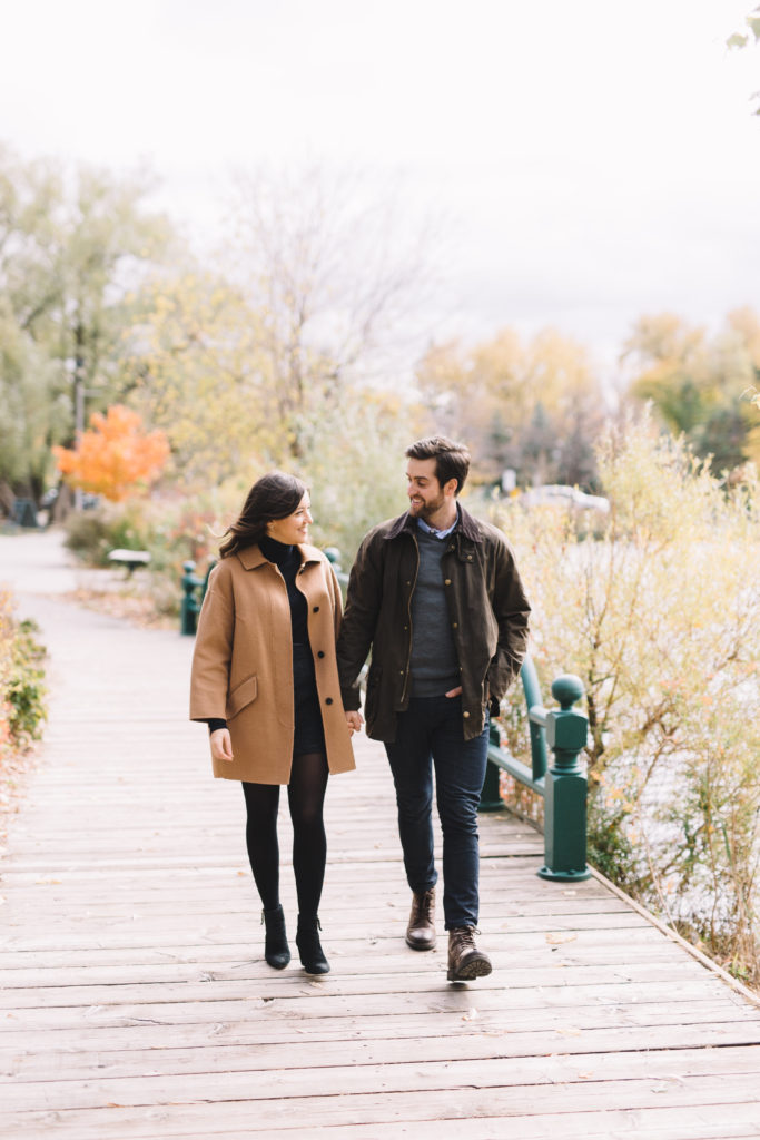 Engagement photo pf couple walking through Mill Pond