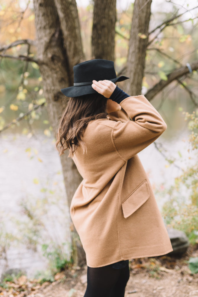 Woman putting on her hat