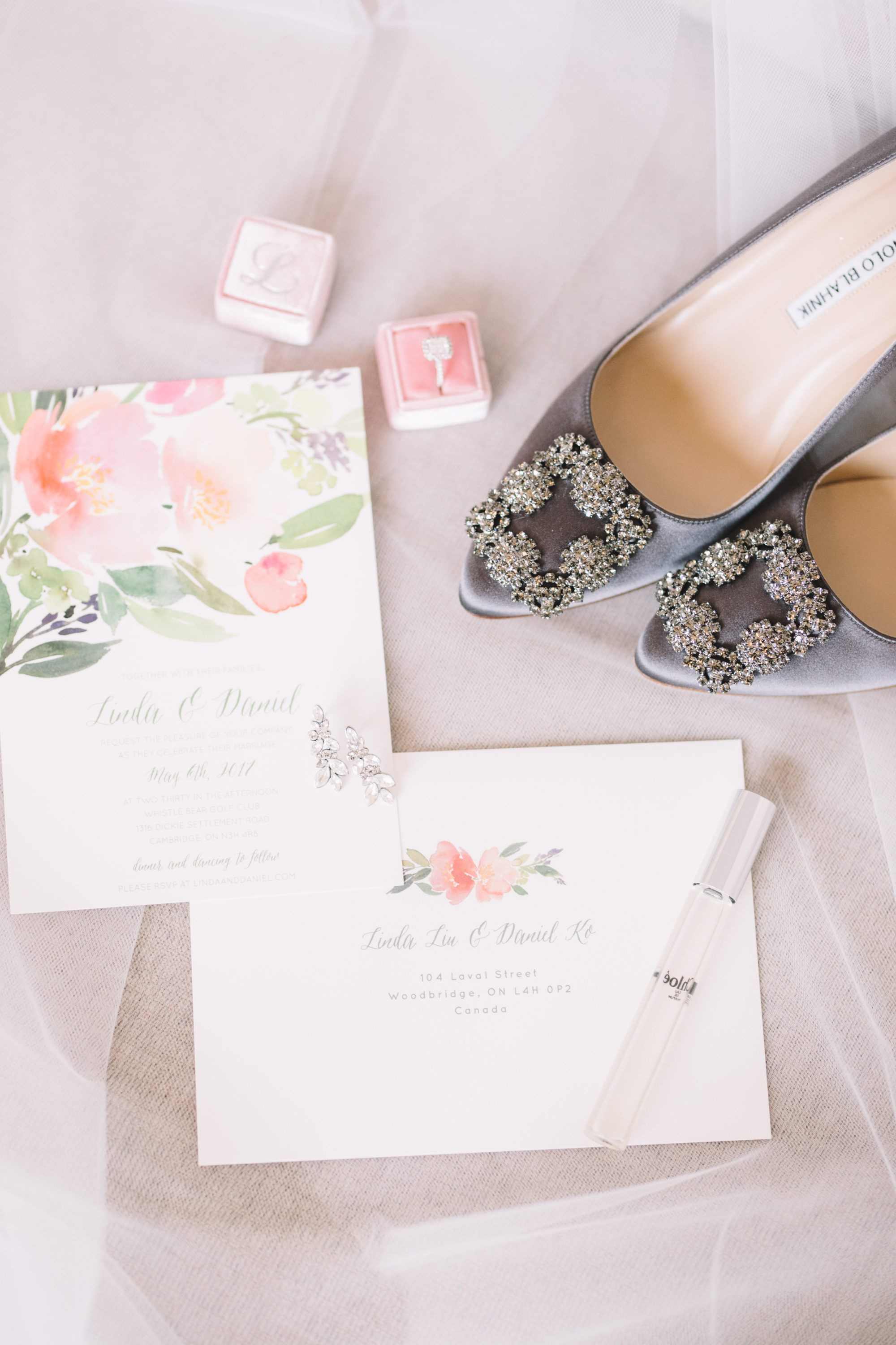 Bridal Detail shots of wedding invitations, engagement ring, wedding shoes