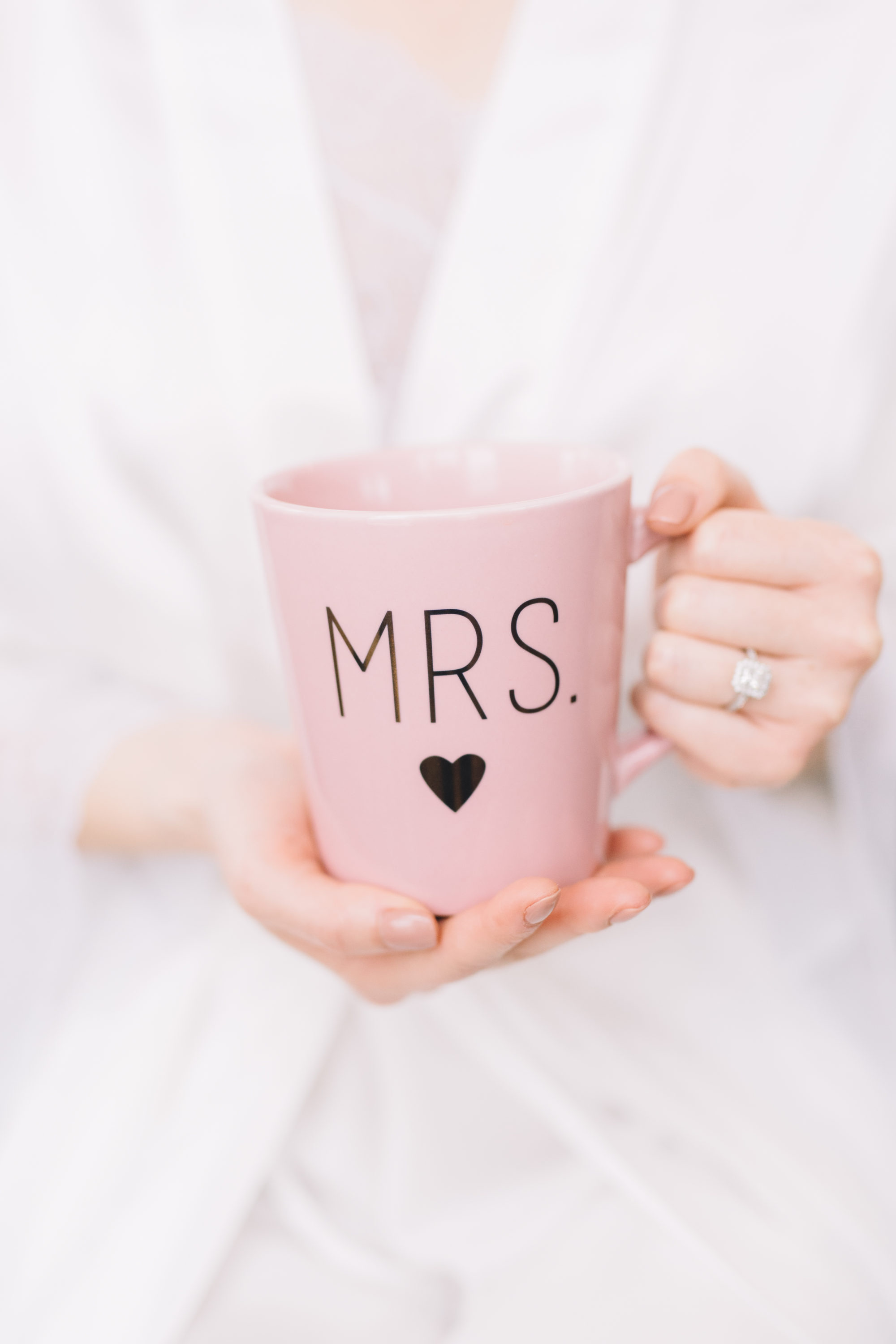Bride holding coffee cup