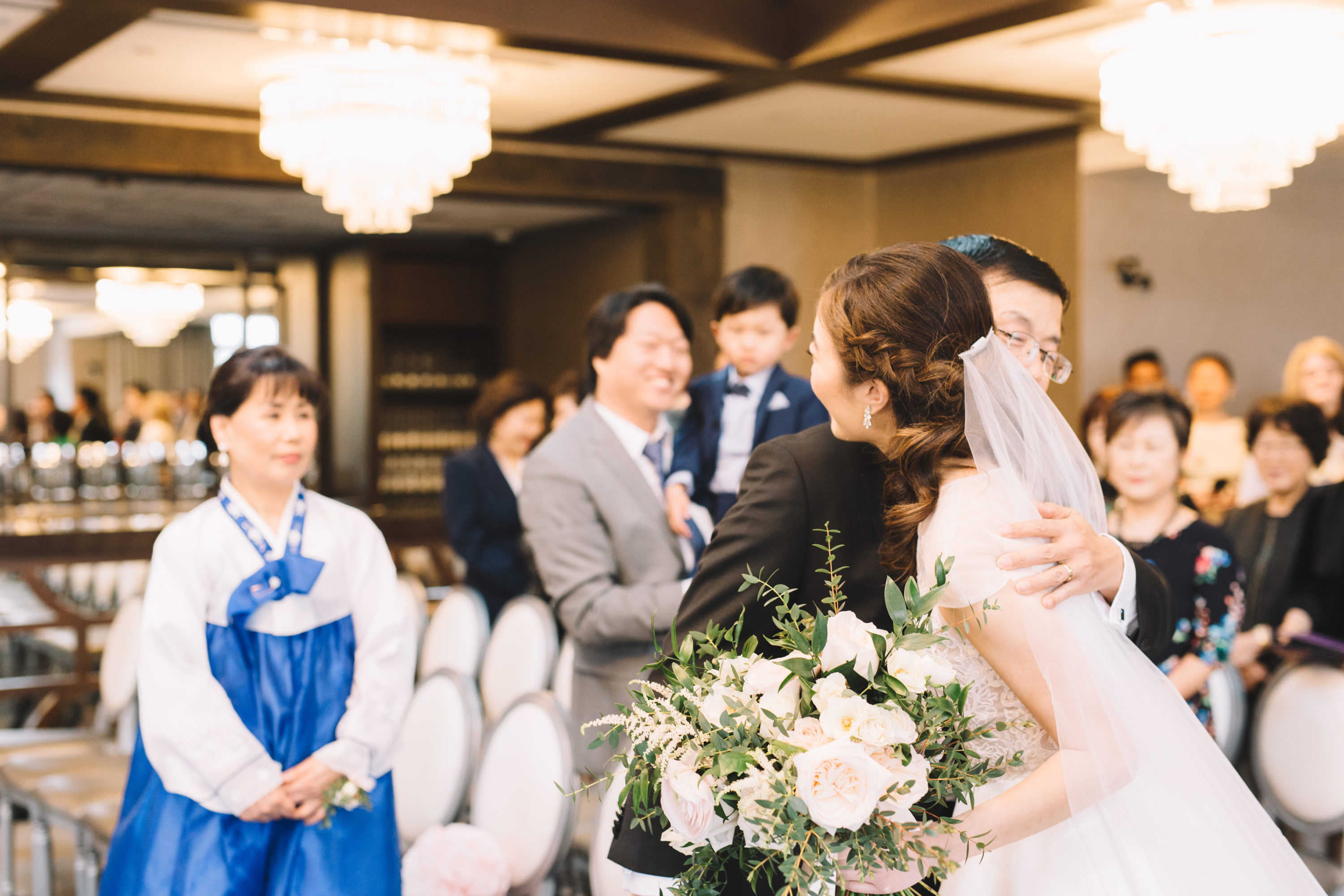 Bride hugging father at ceremony