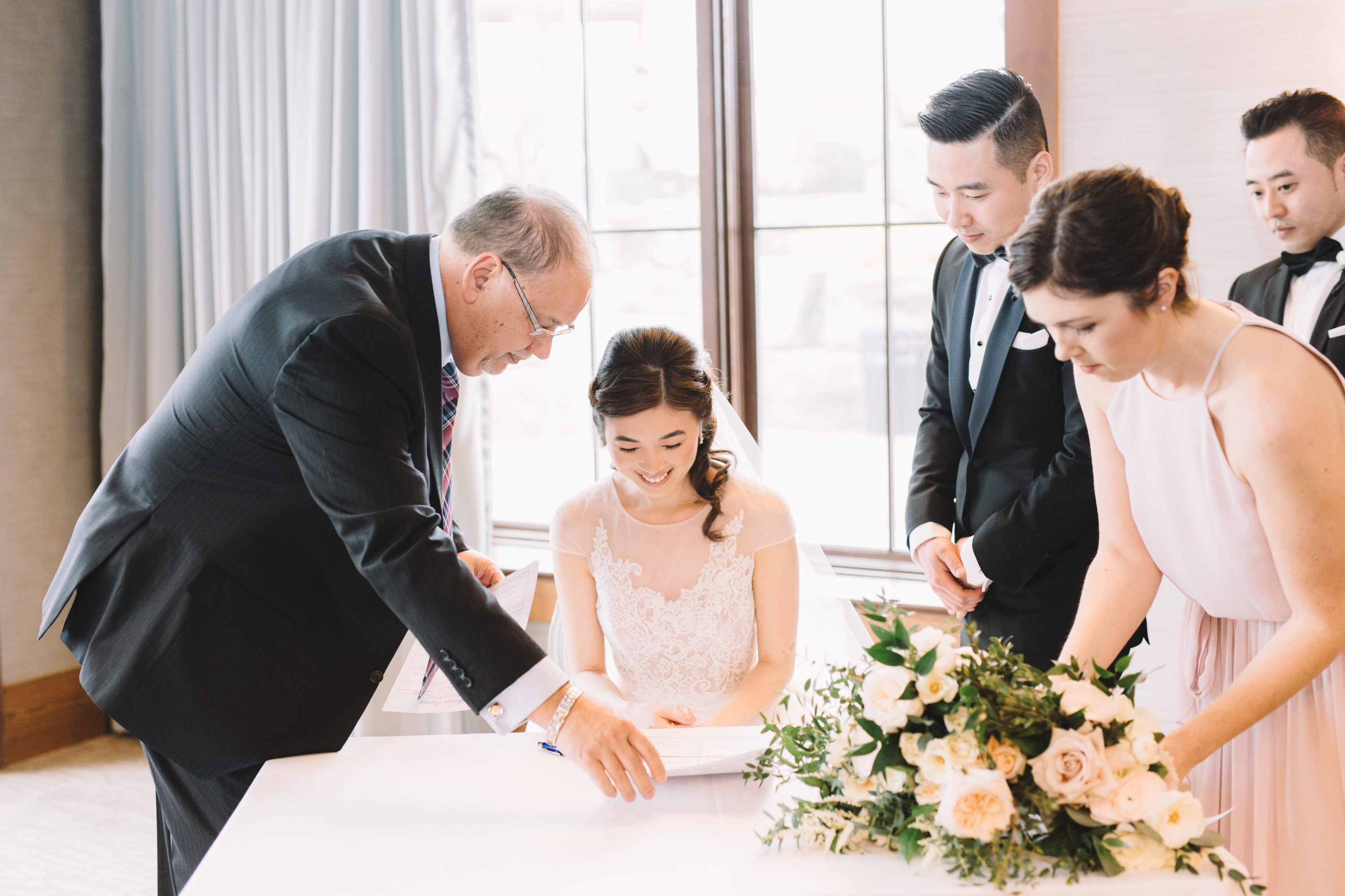 Bride signing papers in Grandview Room at Whistle Bear Golf Club Wedding