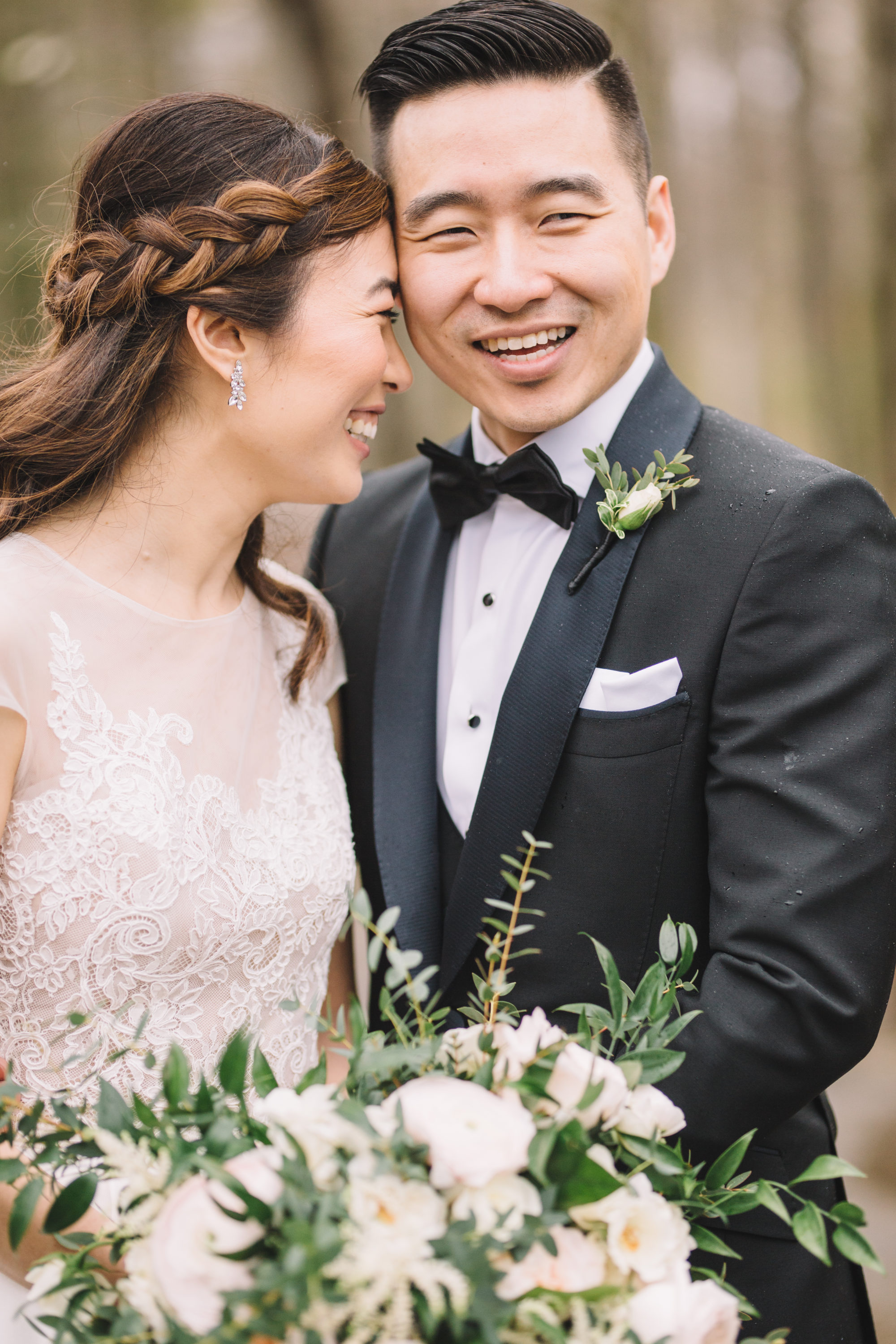 Bride laughing with Groom outside in Forest