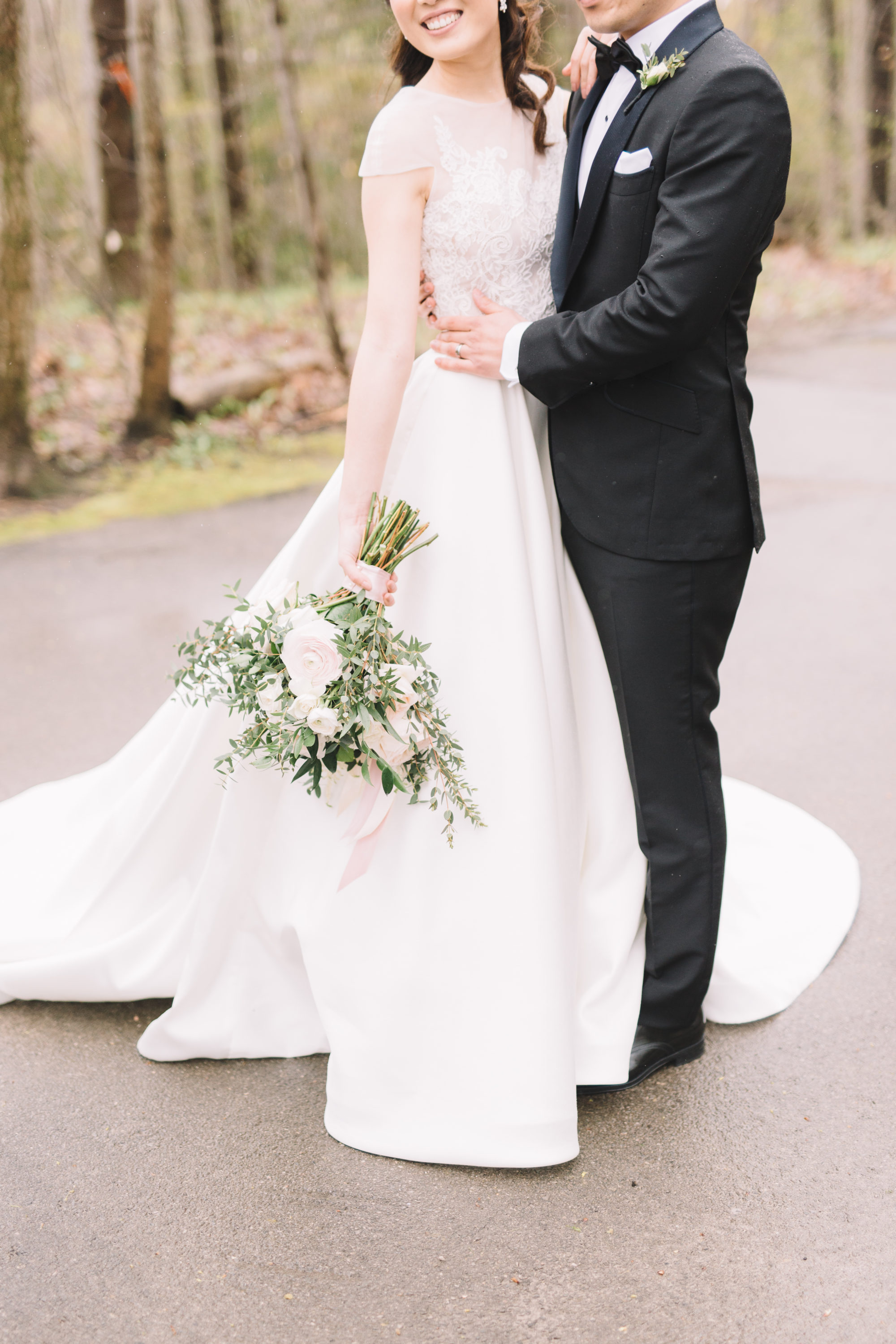 Bride and Groom in rainy forest at Whistle Bear