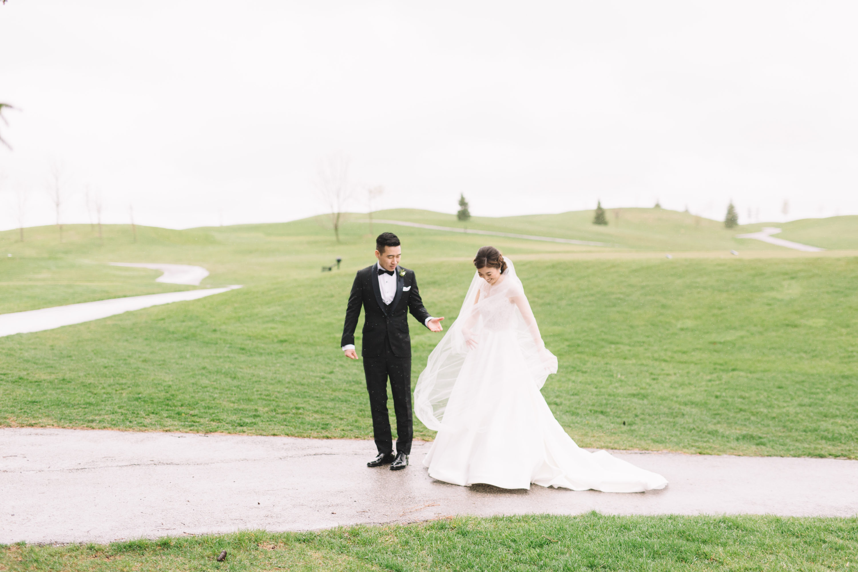 Bride walking on golf course at Whistle Bear