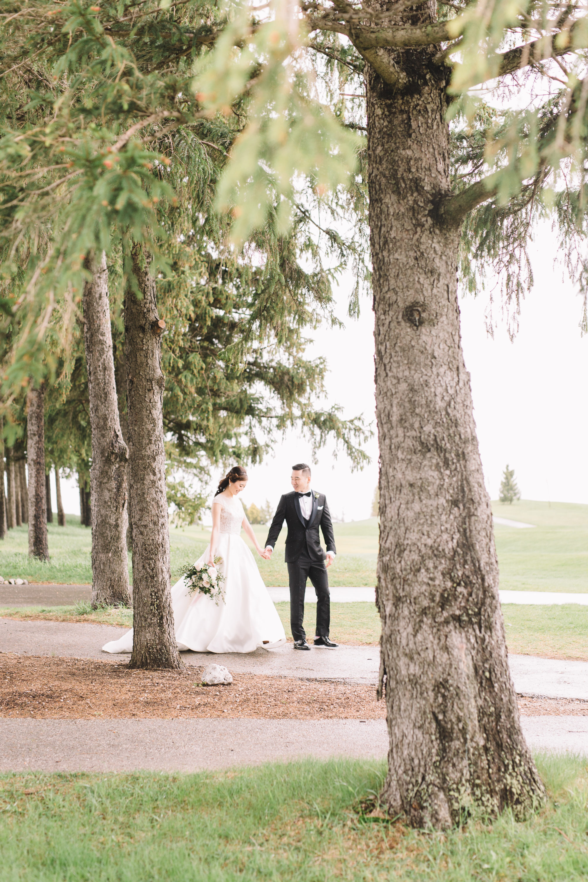 Bride and Groom walking on golf course at Whistle Bear
