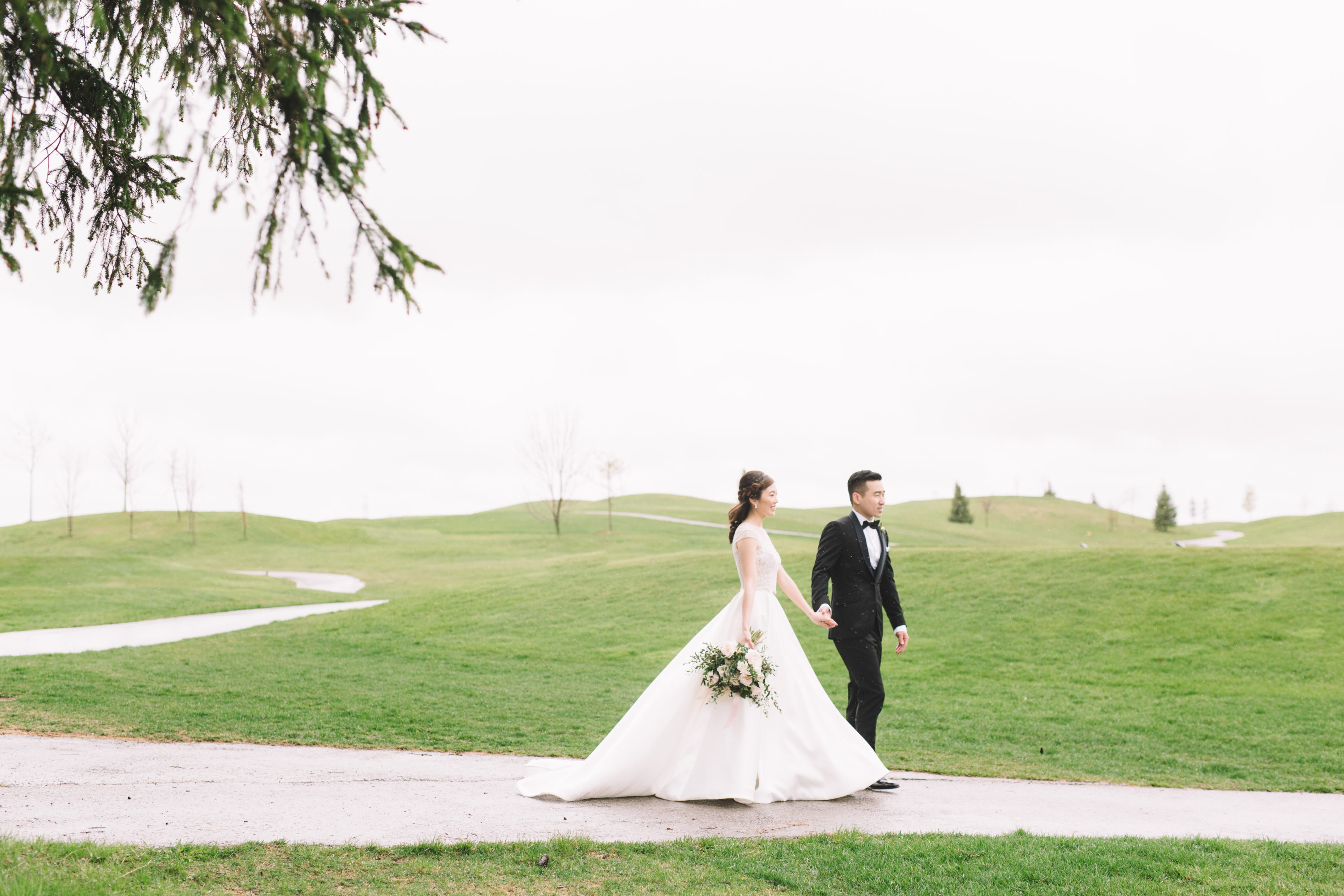 Bride and groom walking at Whistle Bear