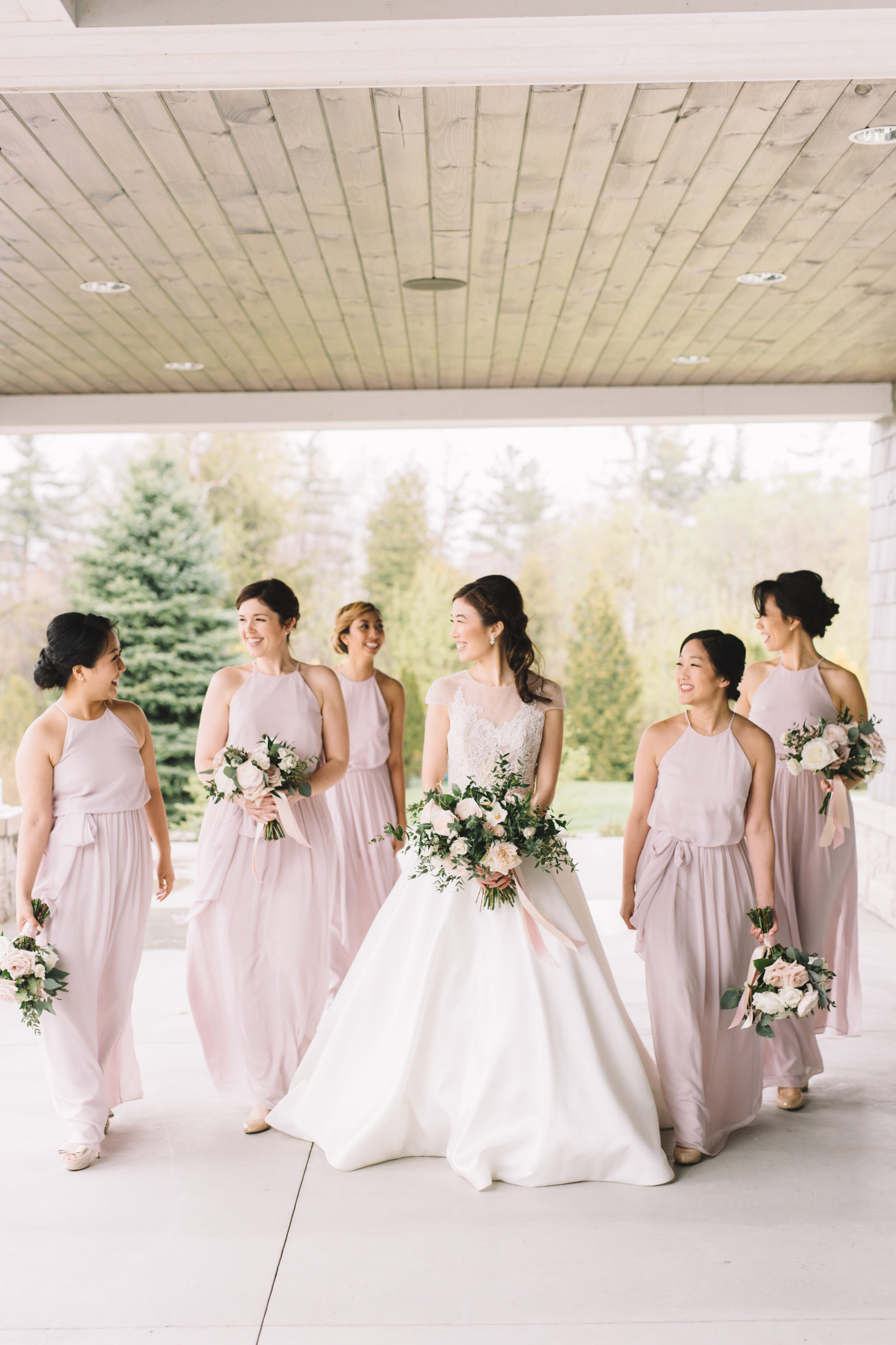 Bride walking with Bridesmaids at Whistle Bear Golf Club