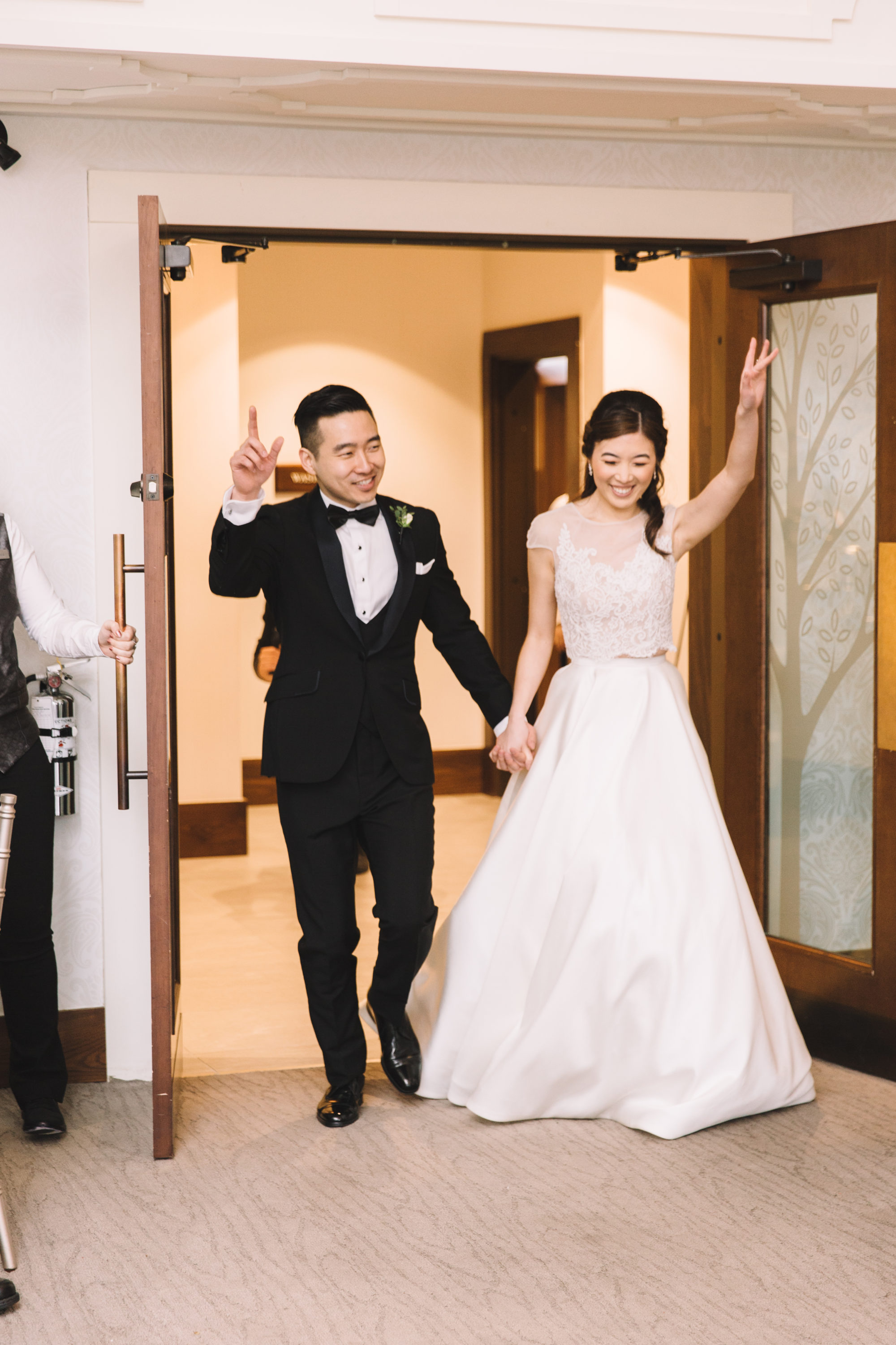 Bride and groom enter forestview room at Whistle Bear