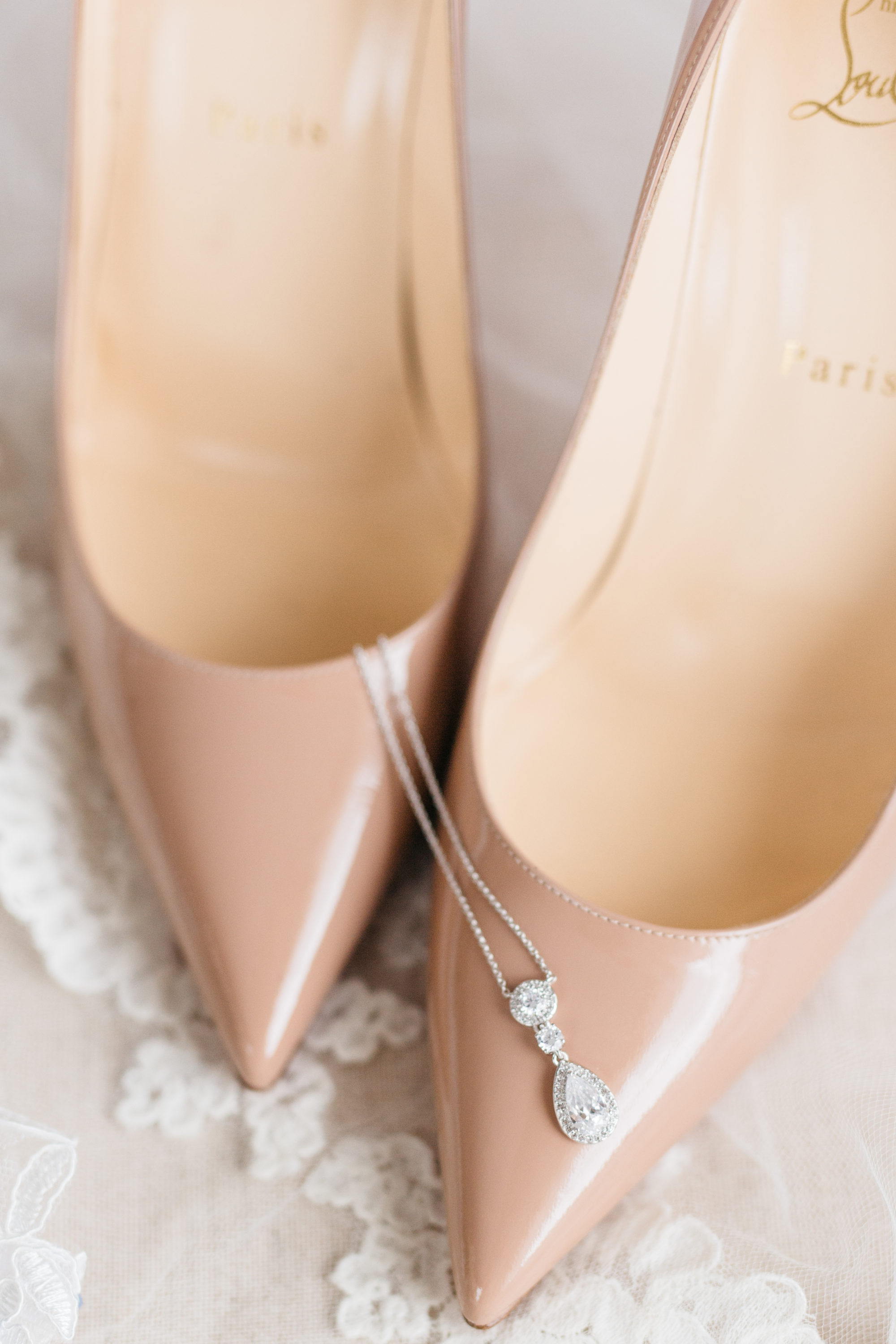 Bride's necklace and Louboutin shoes