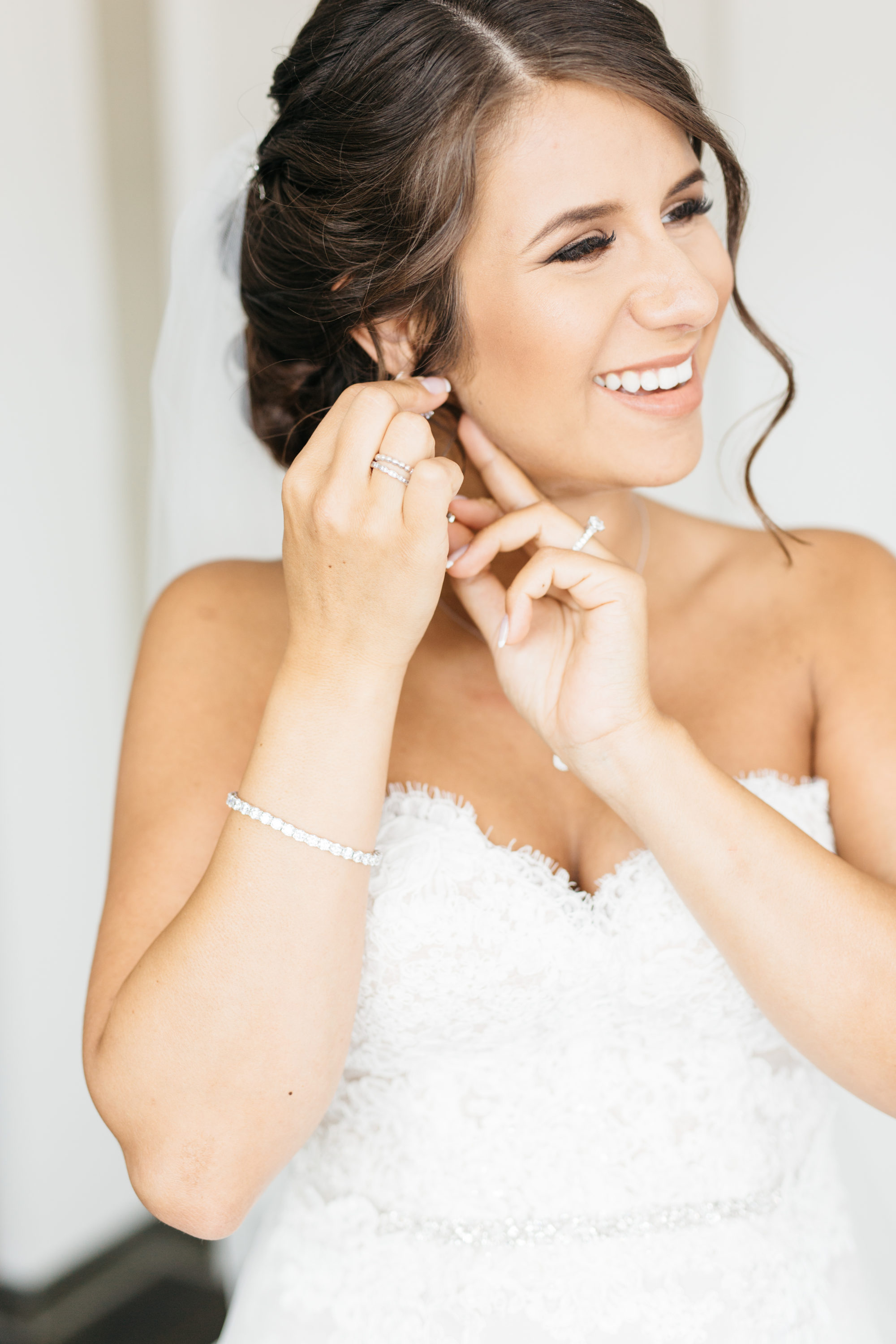 Bride putting on her jewellery