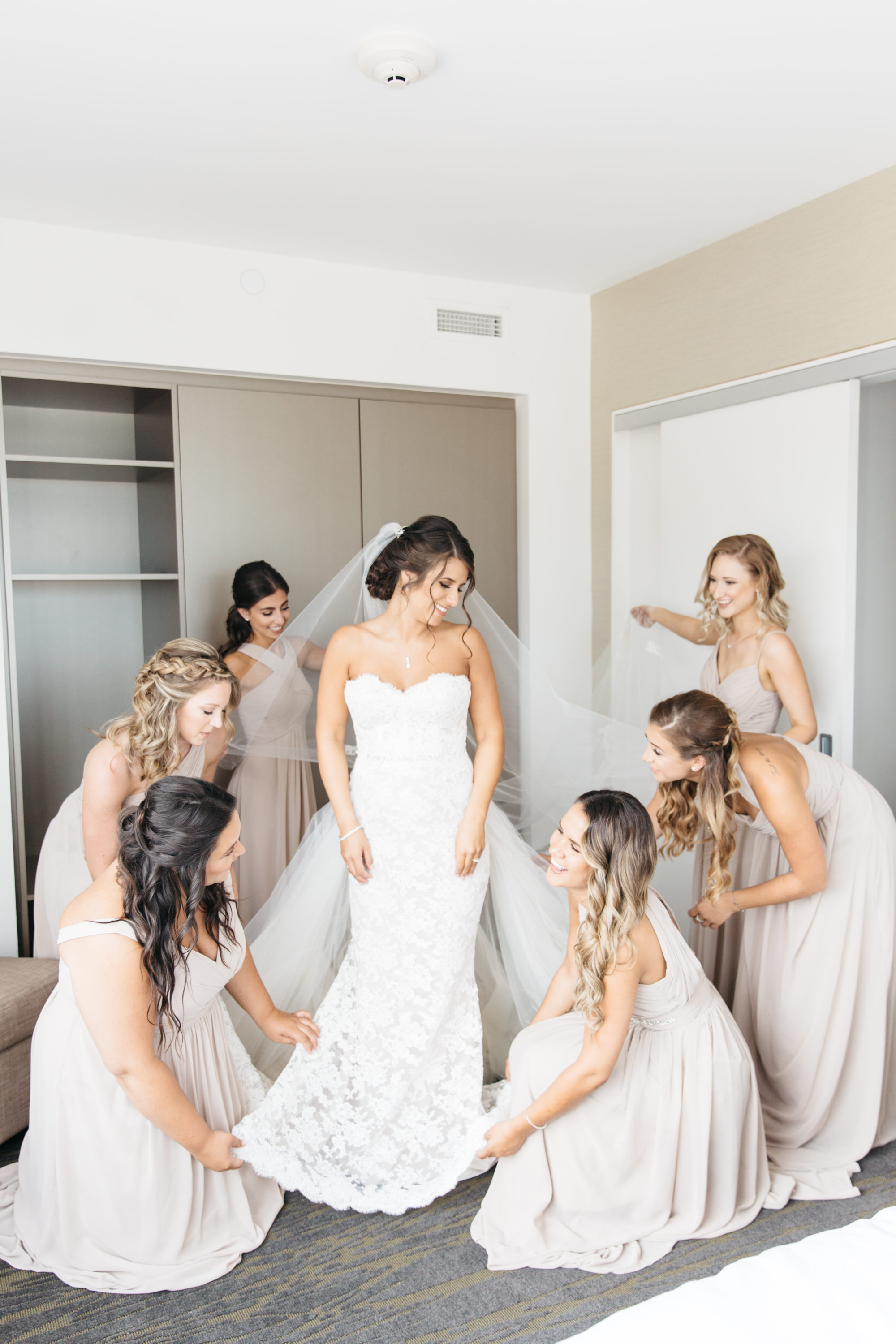 Bridesmaids helping bride get ready at Elements Vaughan Southwest Hotel