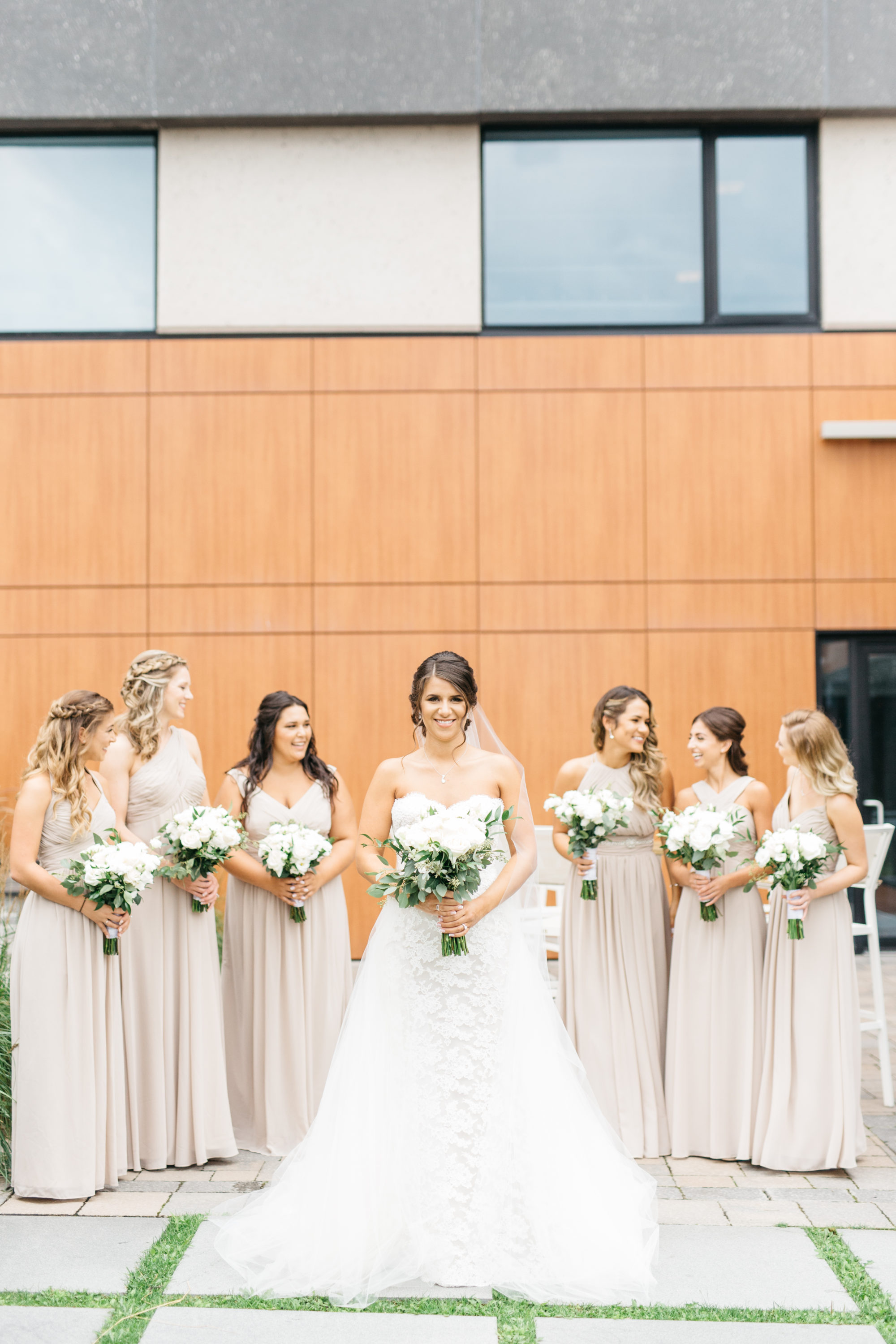 Bride with bridesmaids outside of Elements Vaughan Southwest Hotel