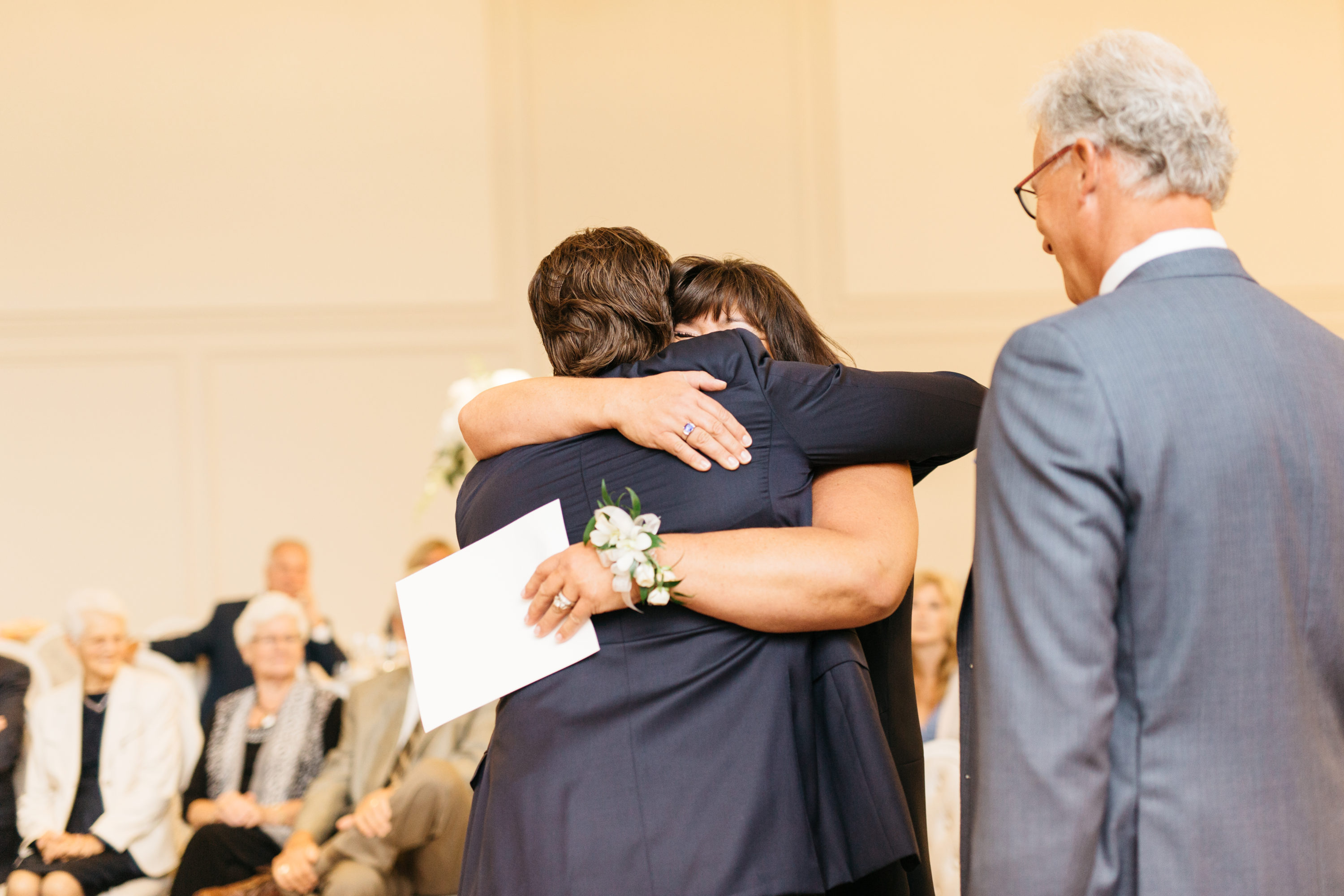 Groom hugging mom during ceremony at the Arlington Estates