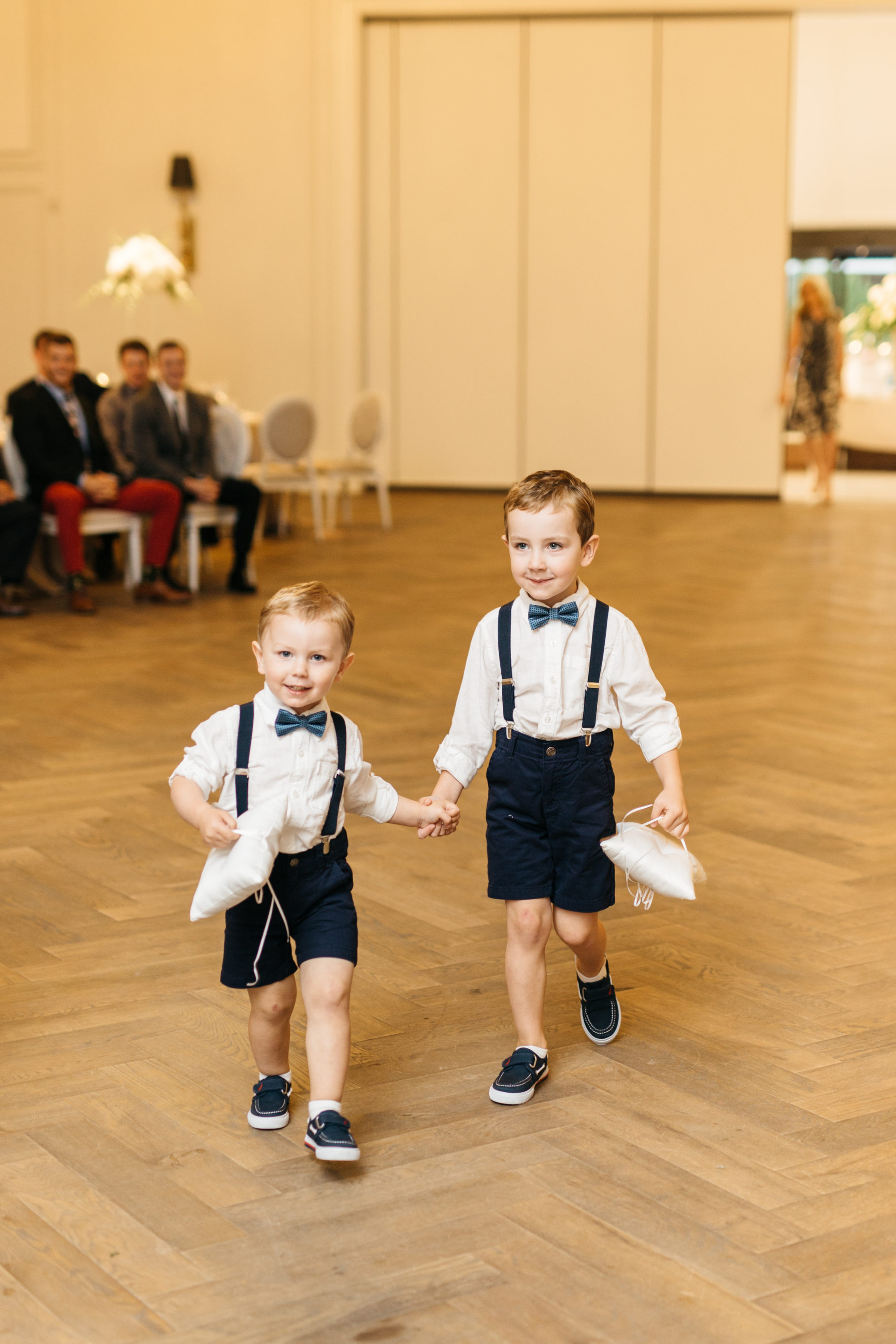Ring boys walking down aisle