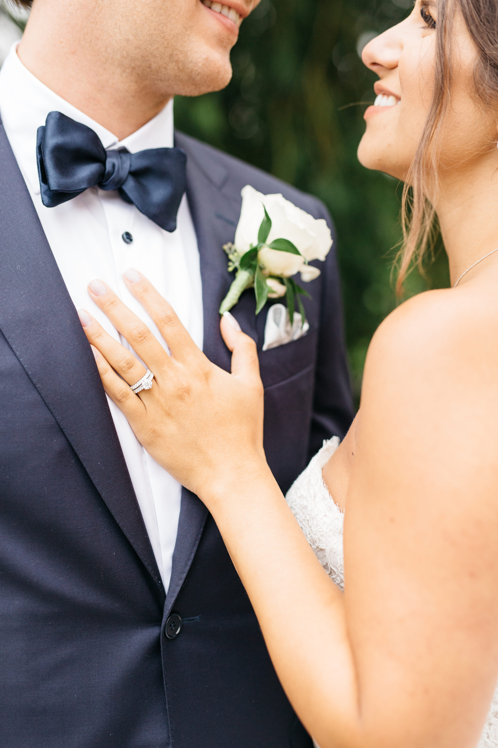Bride's hand on grooms chest