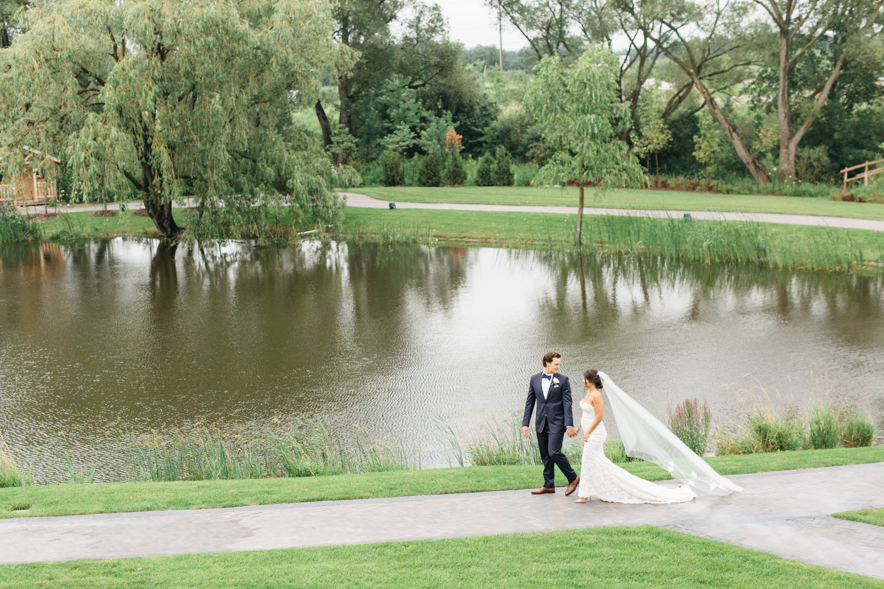 Bride and groom walking the grounds at the Arlington Estate