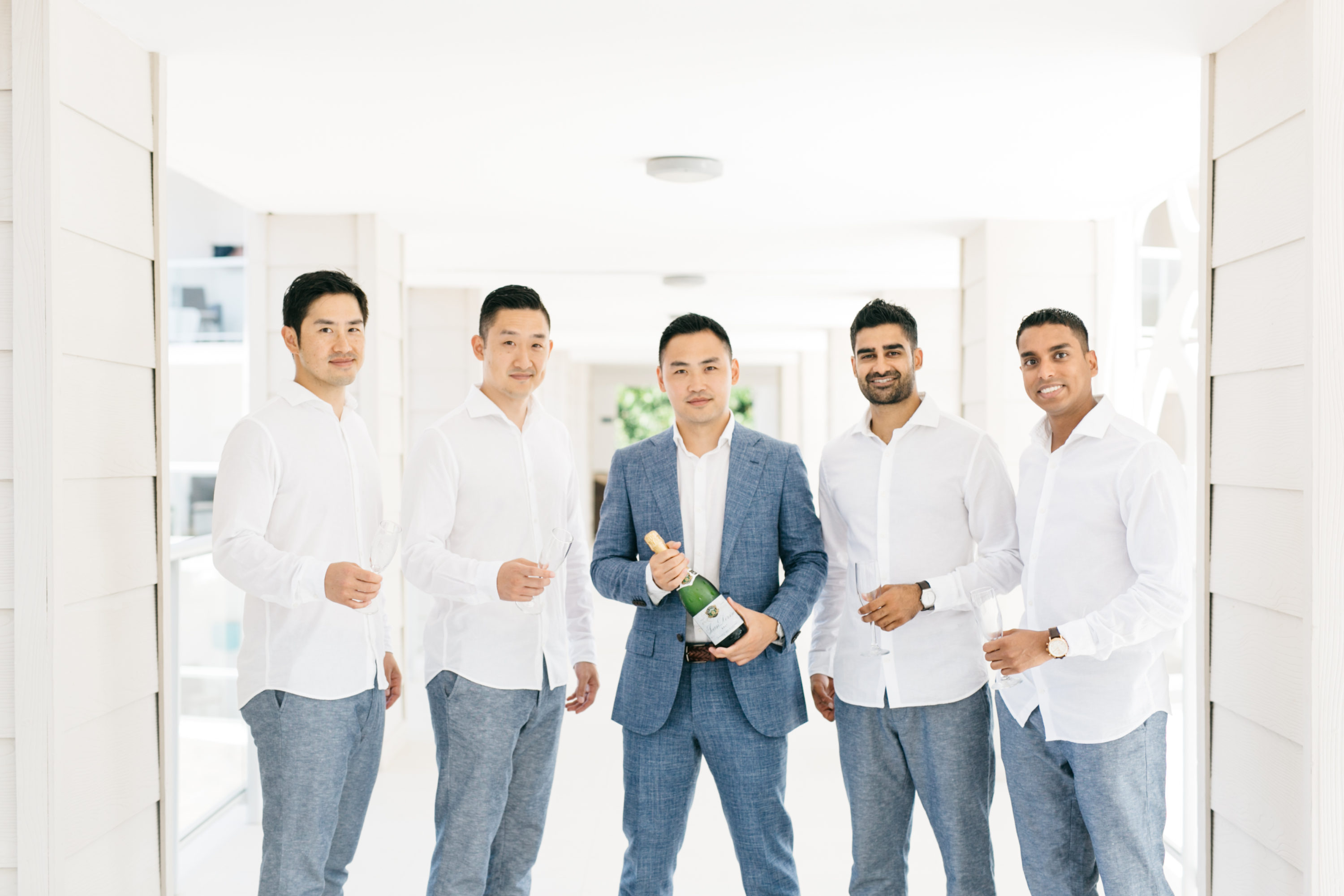 Groom and groomsmen posing at Royalton White Sands Resort in Montego Bay