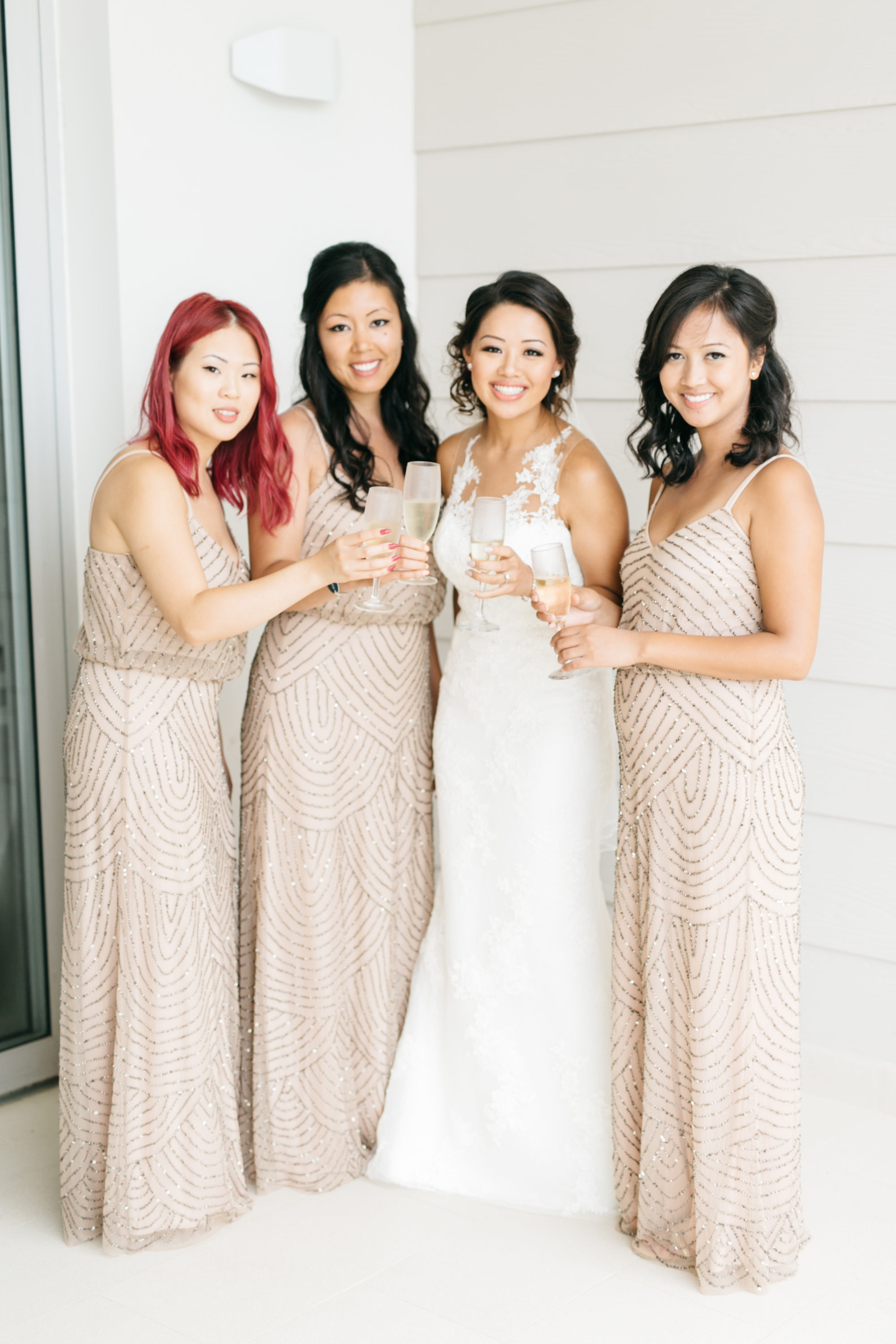 Bride and bridesmaids pouring champagne