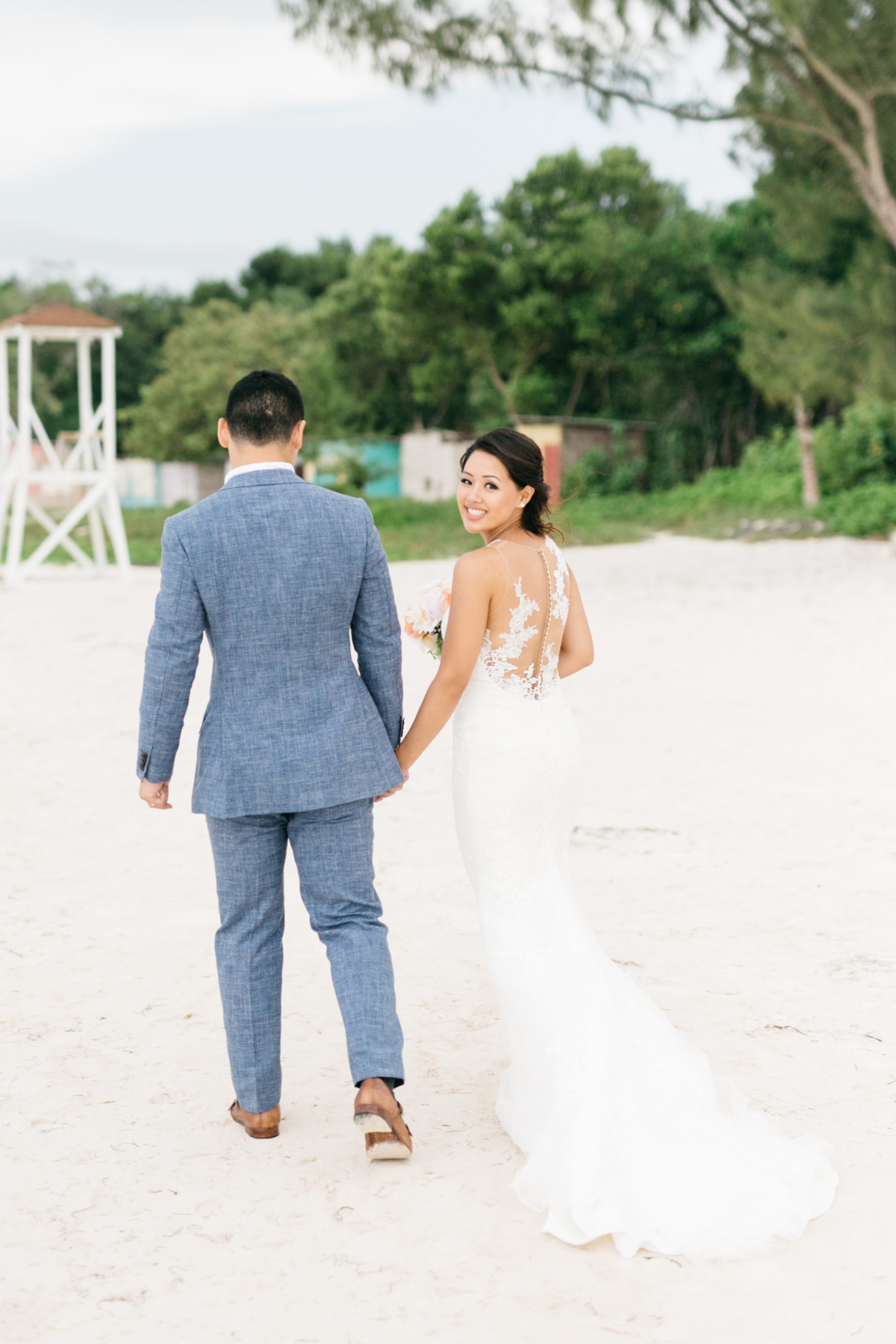 Bride and groom on beach in Jamaica