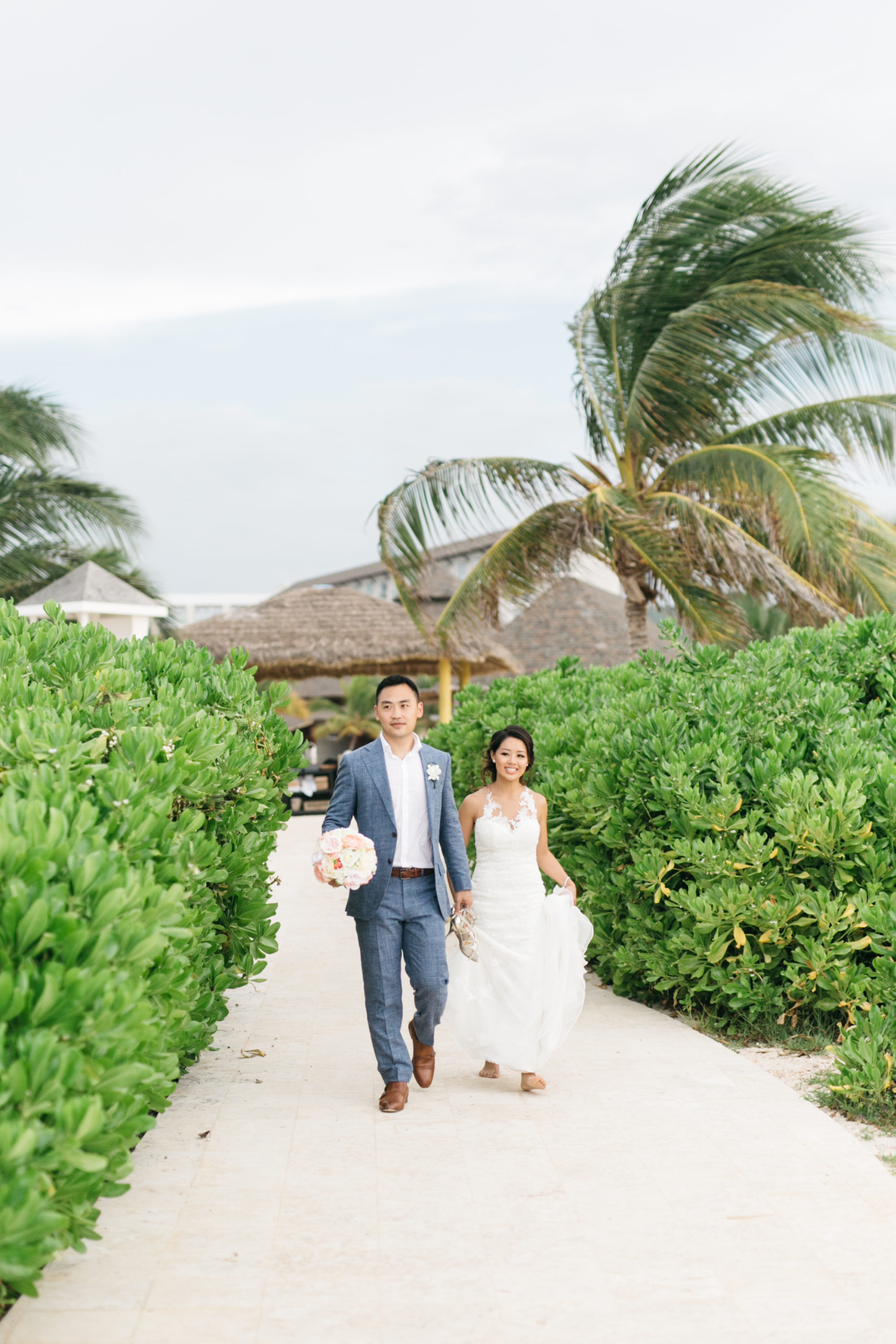 Bride and groom walking on Royalton White Sands Resort